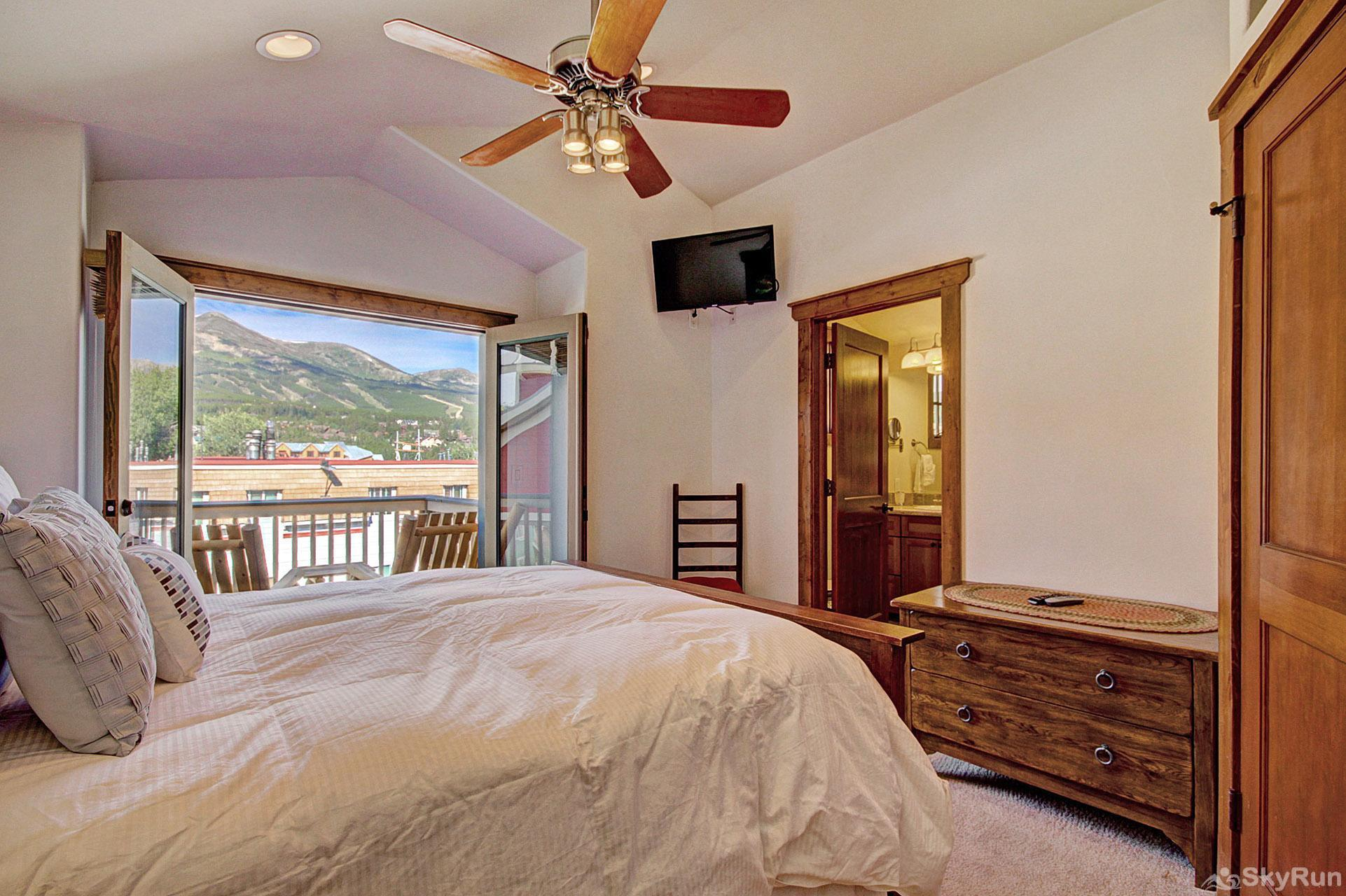 Mountain Ridge Chalet Queen master bedroom with amazing views and ensuite bathroom