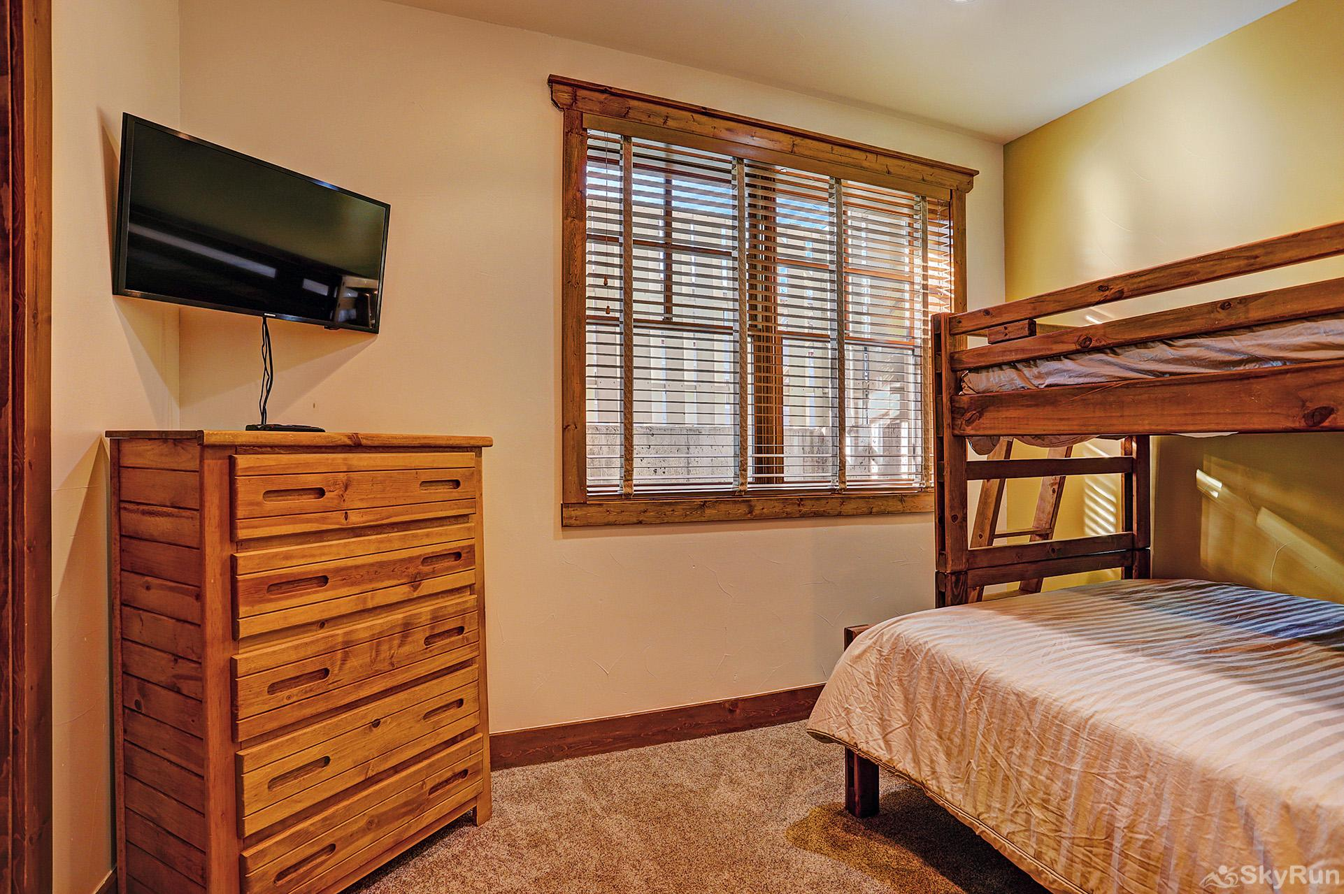 Mountain Ridge Chalet Lower level bunk room with ensuite bath and flat screen TV