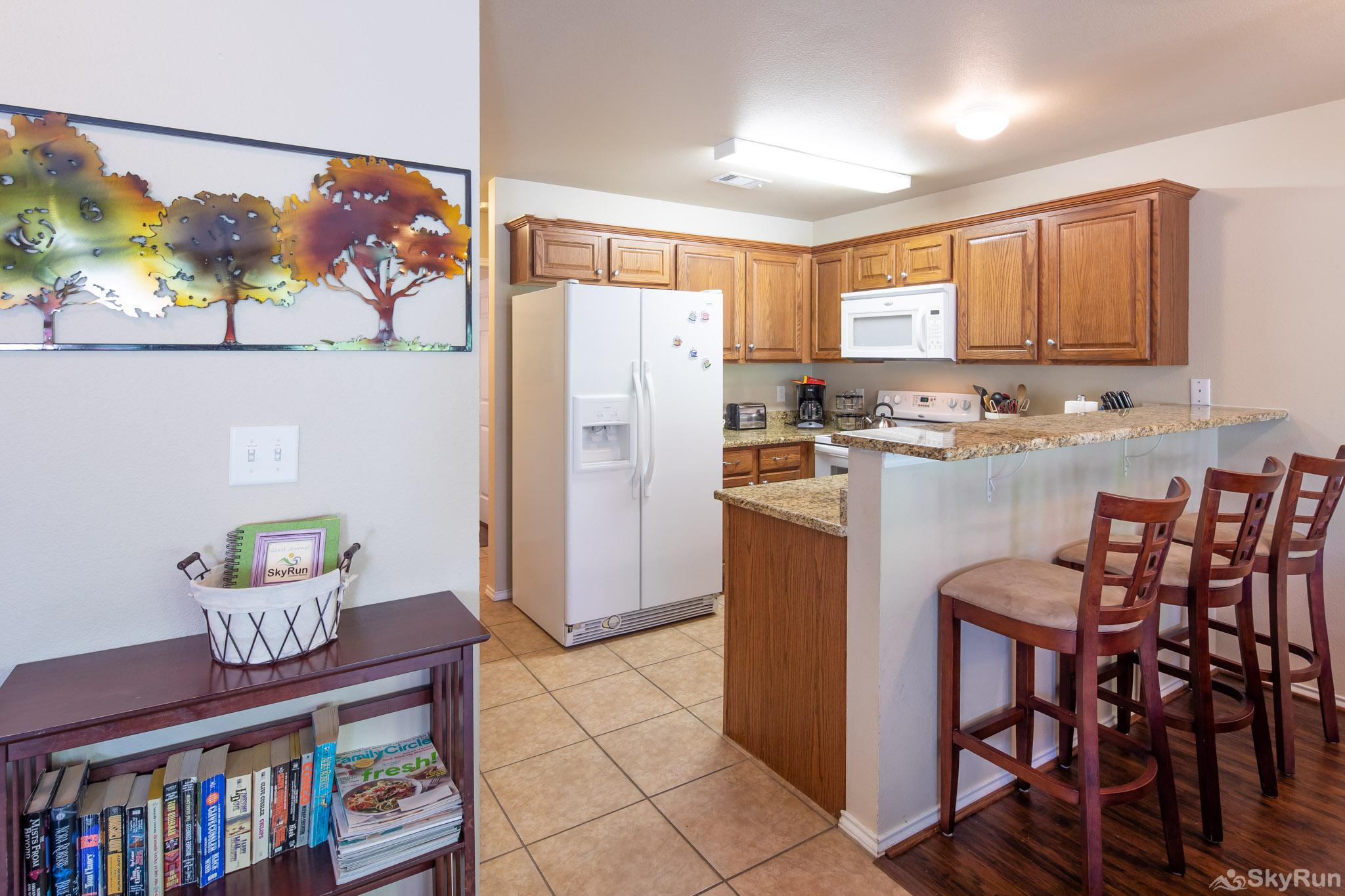 WATERWHEEL TREEHOUSE CONDO Kitchen equipped with all cooking and dining essentials