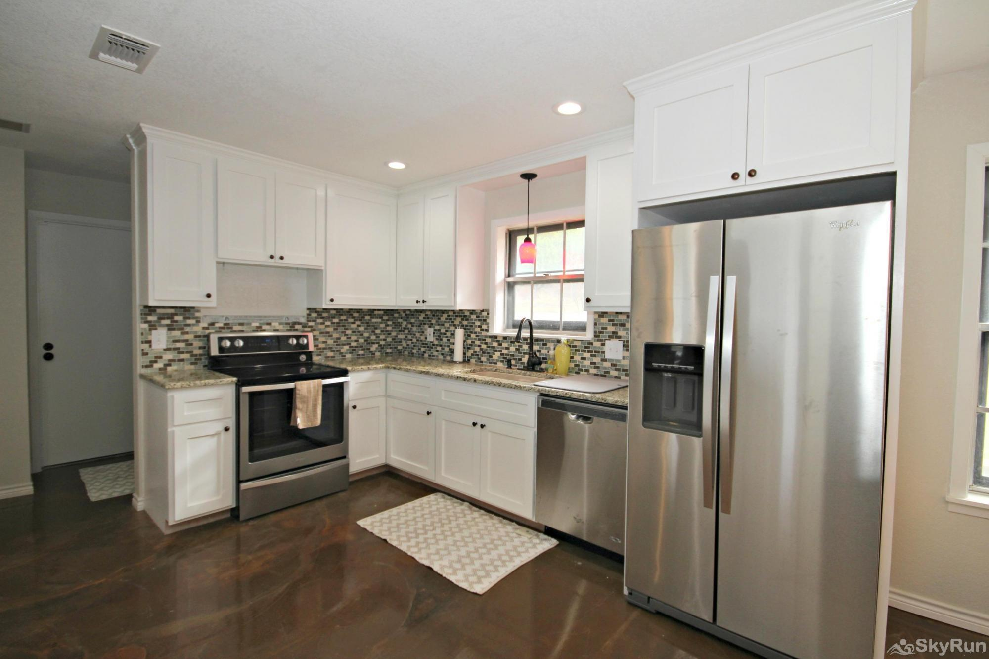 SUNSET VISTAS Kitchen with Granite Tops and Stainless Steel Appliances