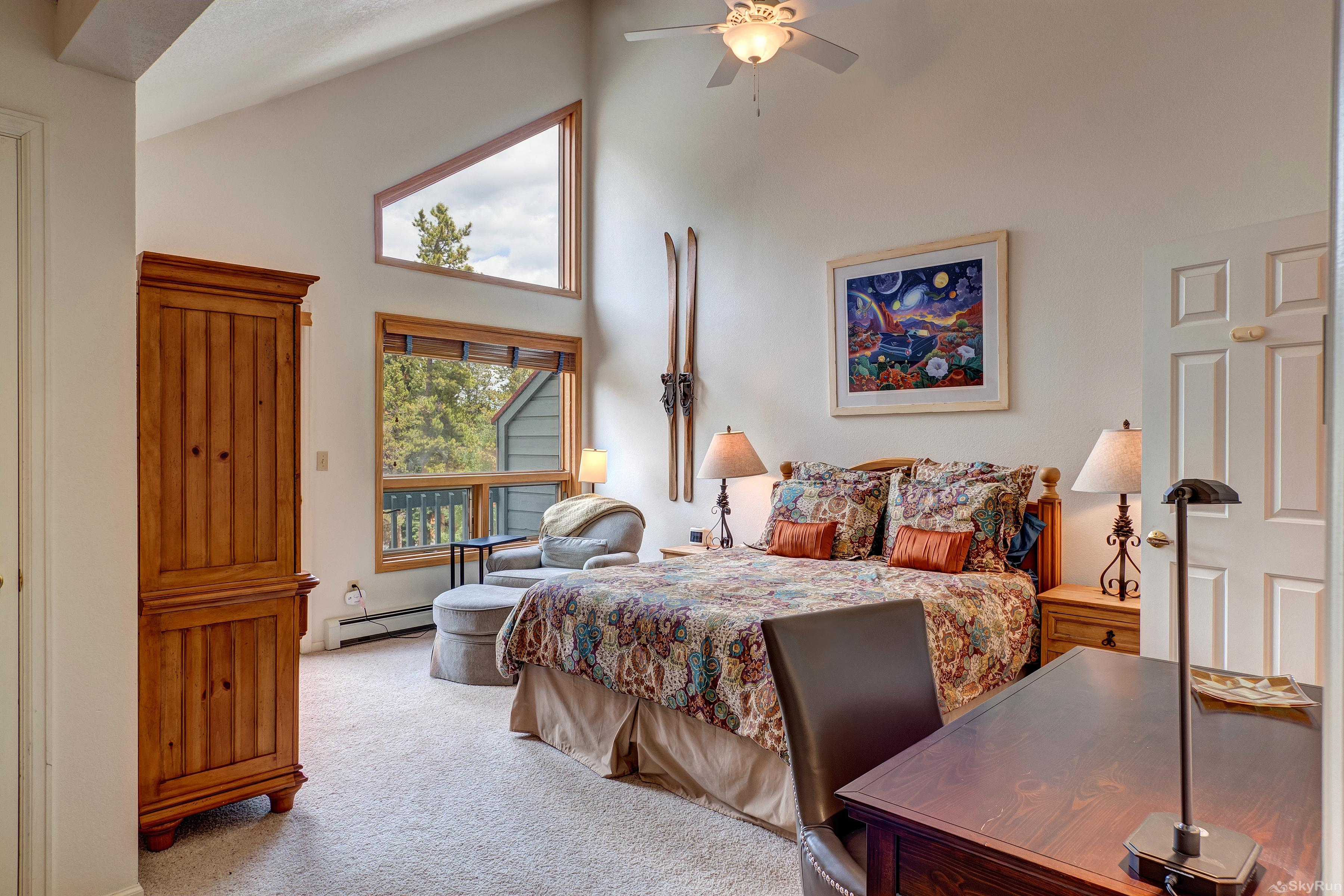 Pine Creek Lodge Queen master bedroom with lots of windows!