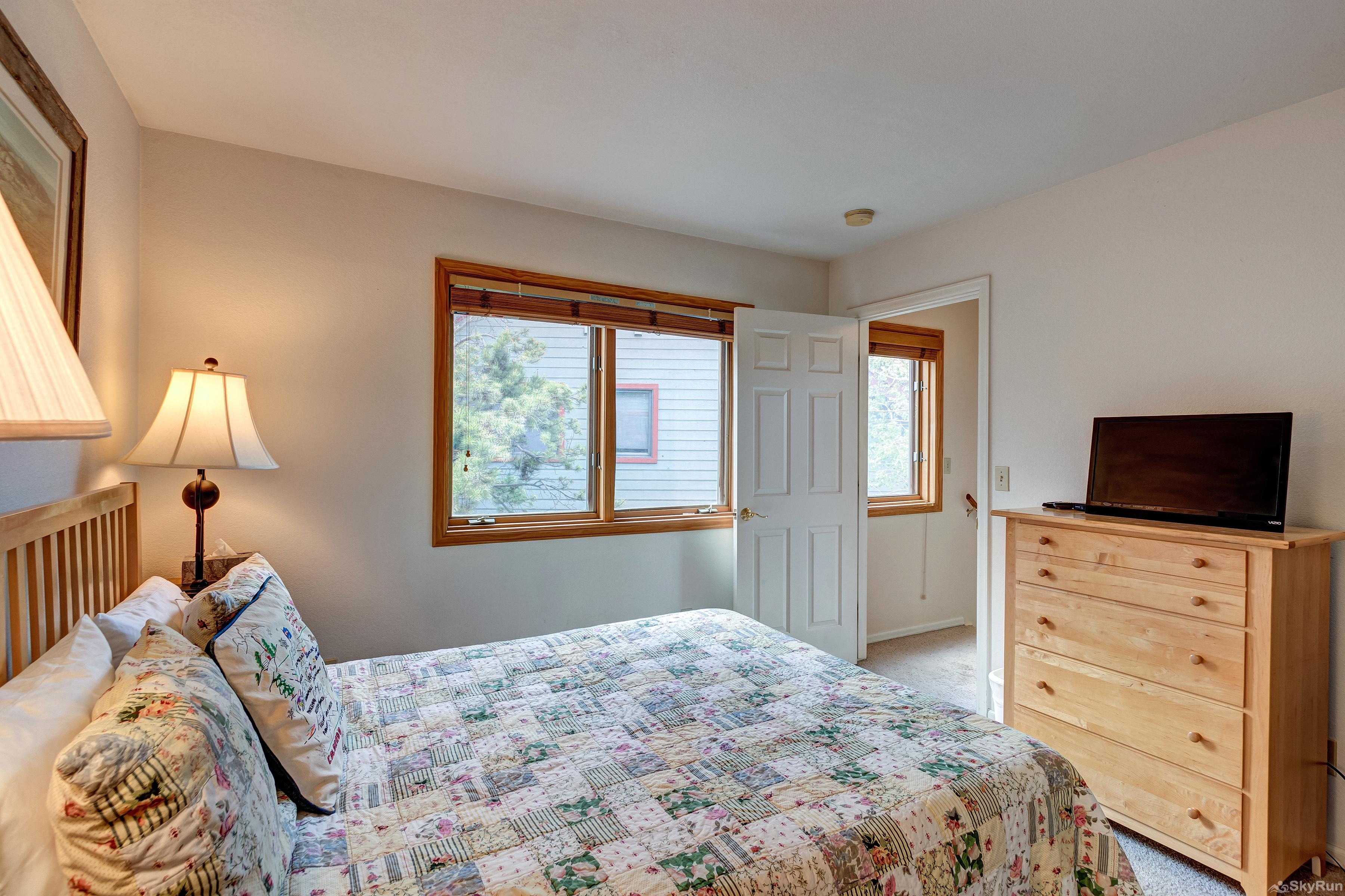 Pine Creek Lodge Queen upper level bedroom with ensuite bath