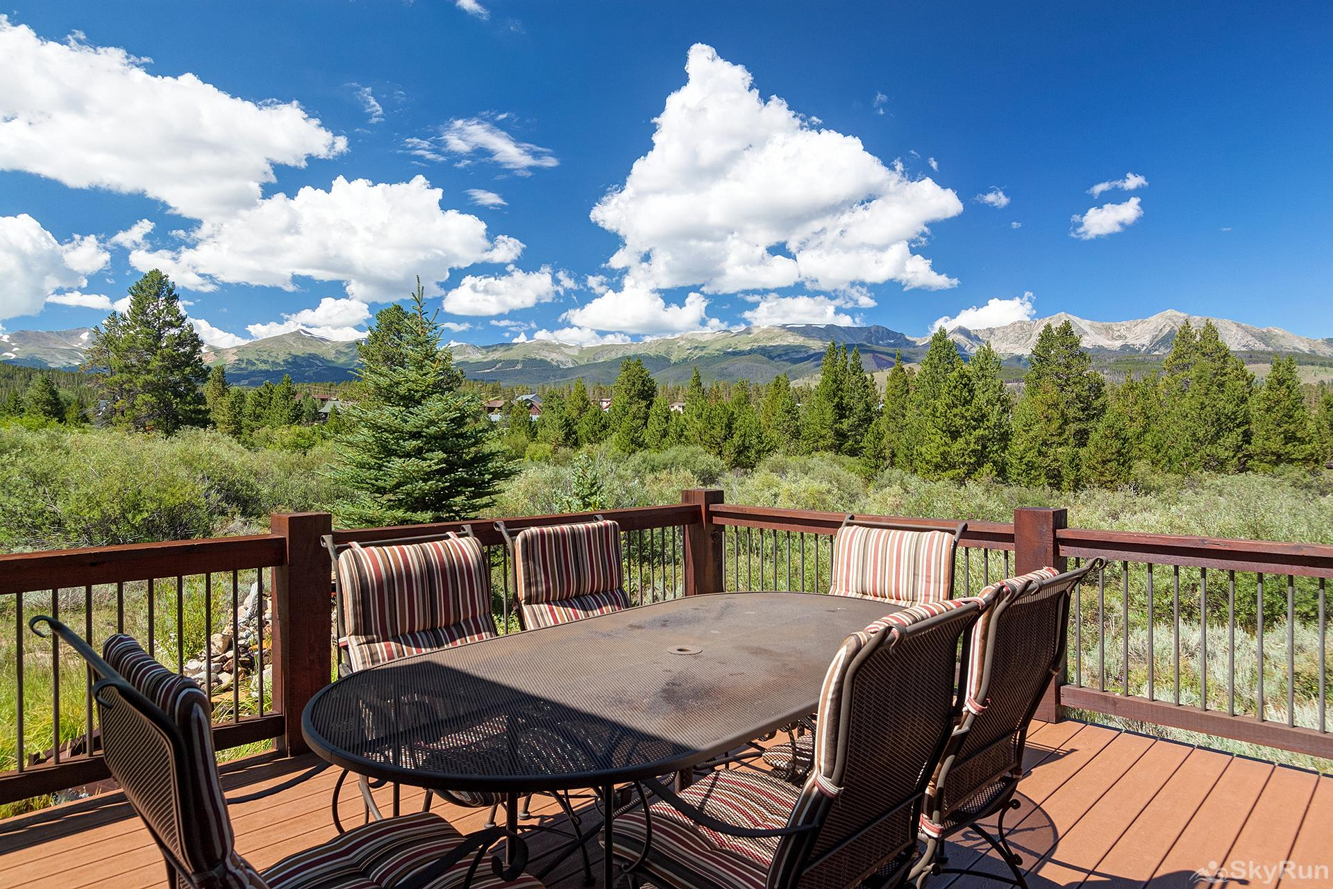 Swan River Retreat Plenty of seating on the upper level deck with mountain views **PATIO SET NOT USABLE IN WINTER**