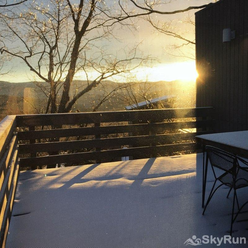16 Village Run Sunshine over snow-covered deck