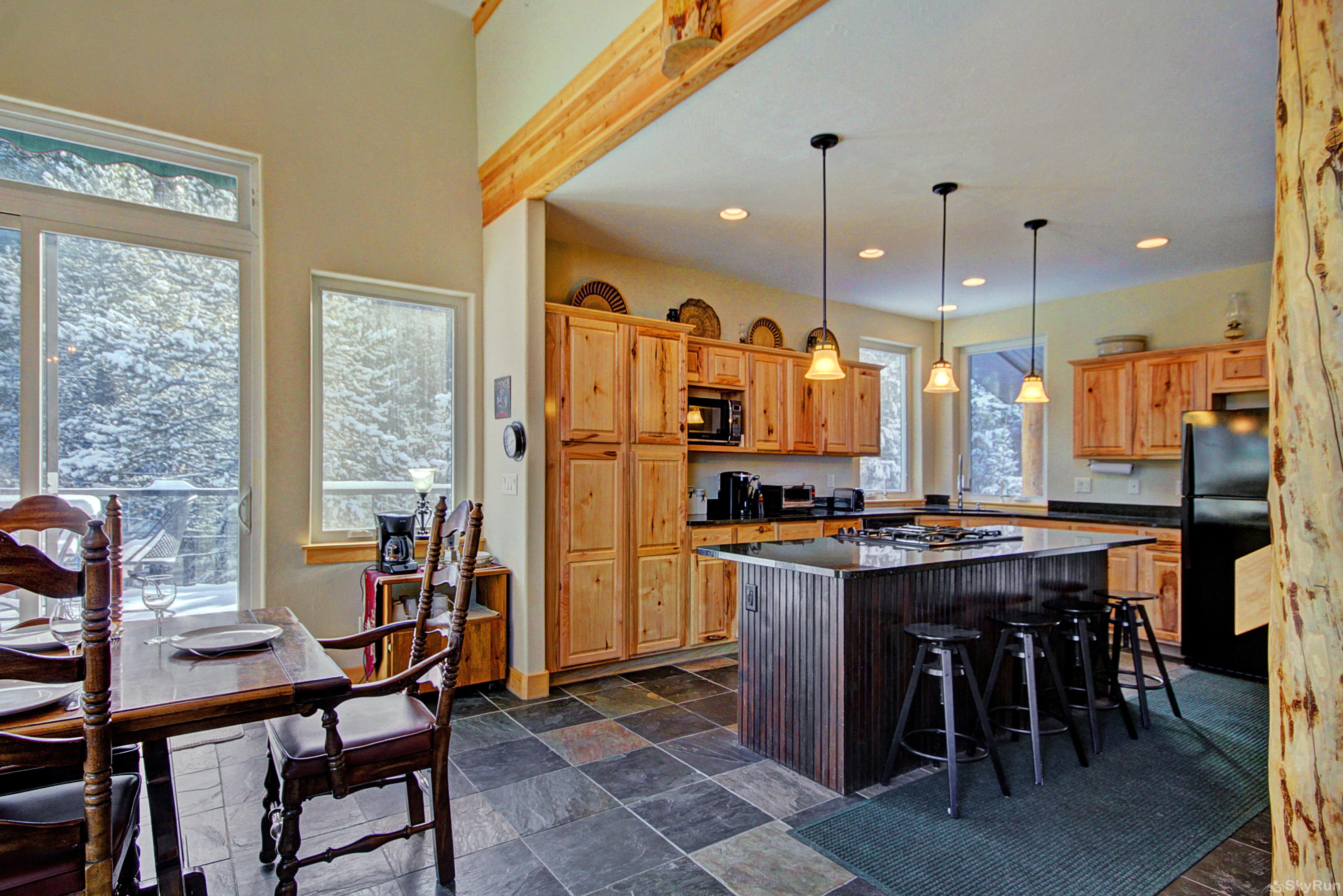 Twin Creek Lodge Kitchen opens up to dining and living room areas