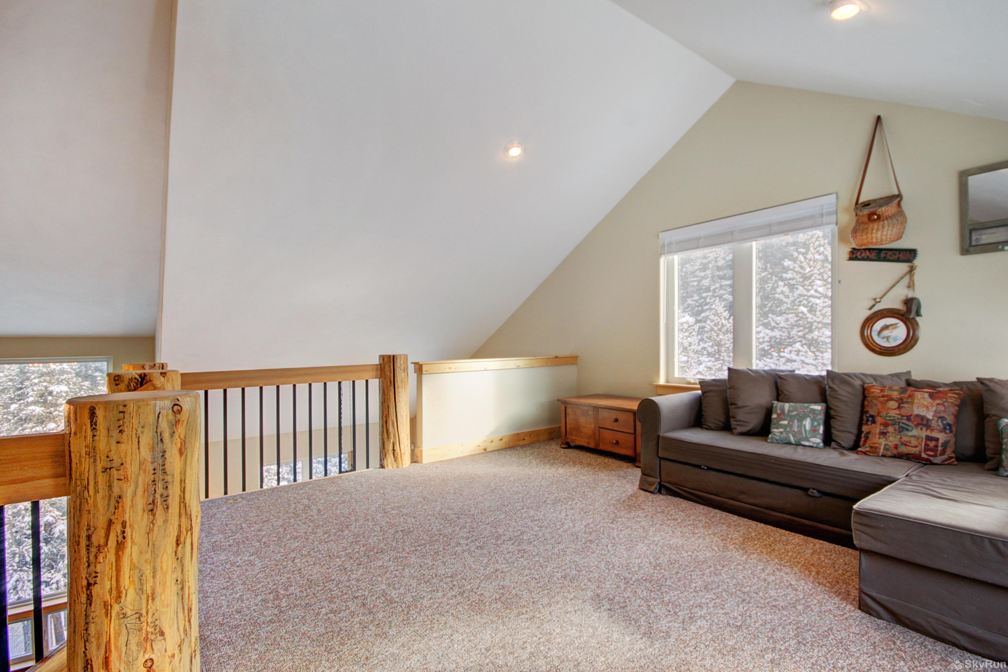 Twin Creek Lodge Full size sleeper sofa provides additional sleeping accommodations in upper level loft