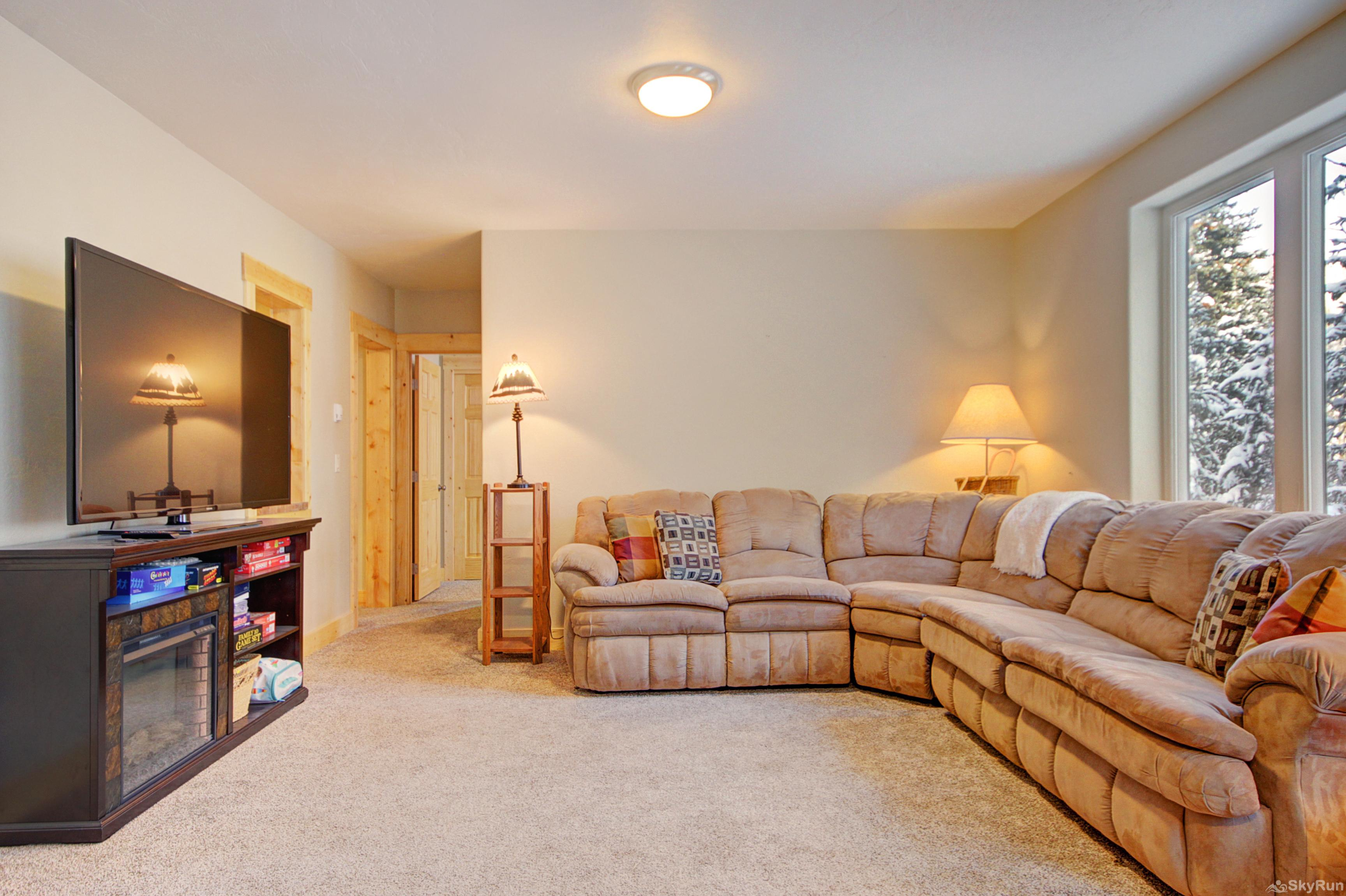Twin Creek Lodge Large lower level living room with flat screen TV
