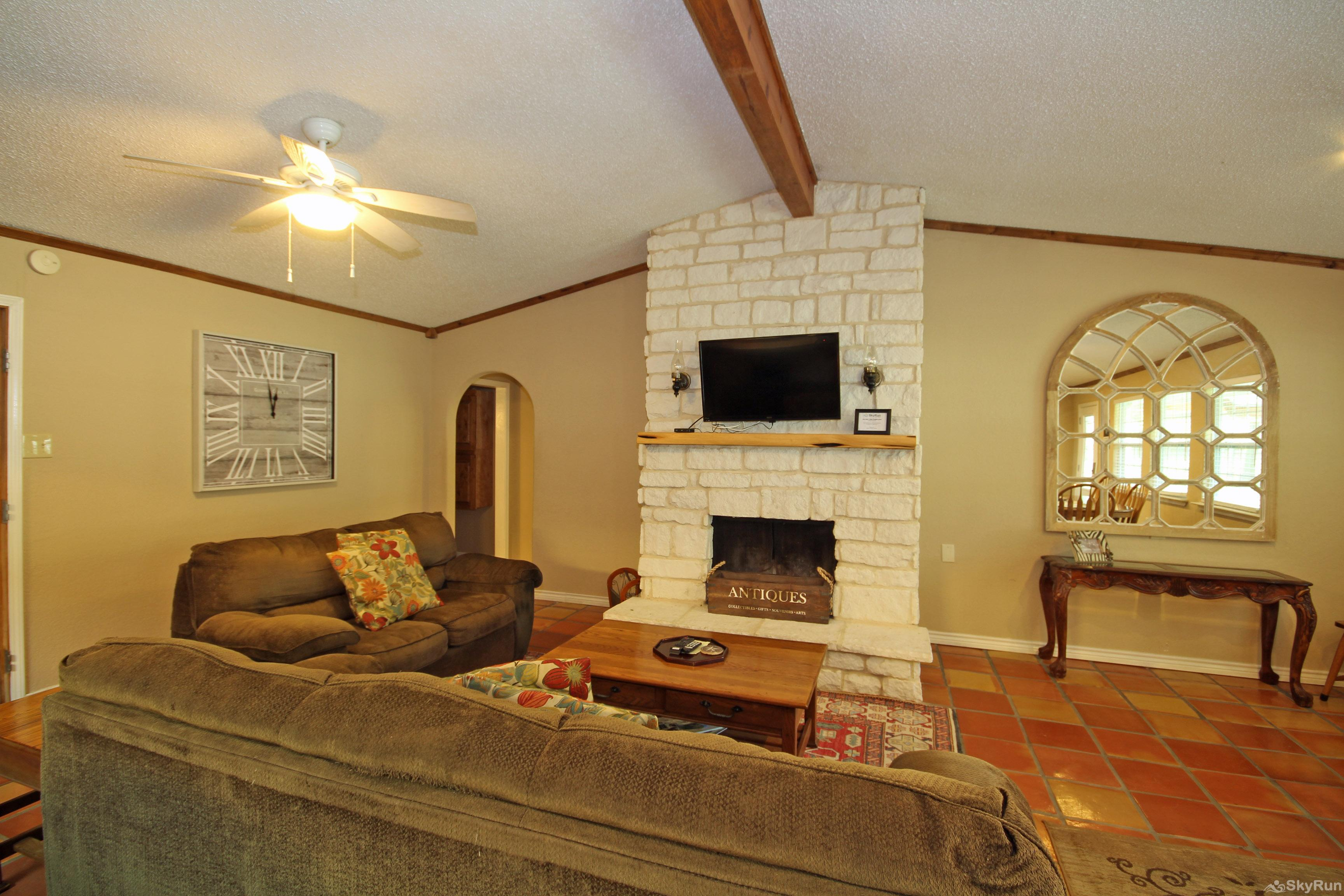 STAR OF TEXAS AND COTTAGE COMBO Living area with HDTV