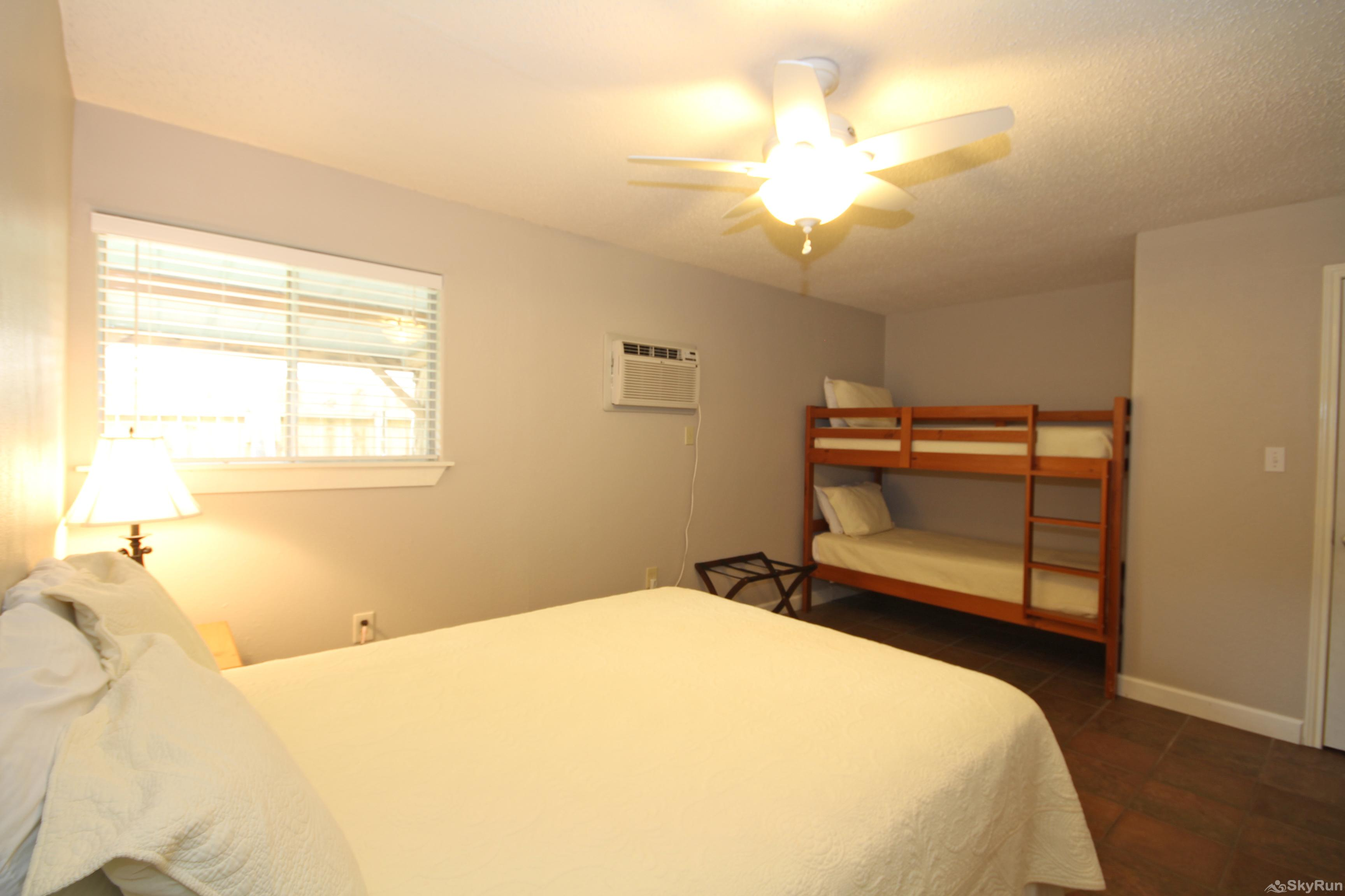 STAR OF TEXAS AND COTTAGE COMBO Second Bedroom with Queen and Twin Bunk Beds