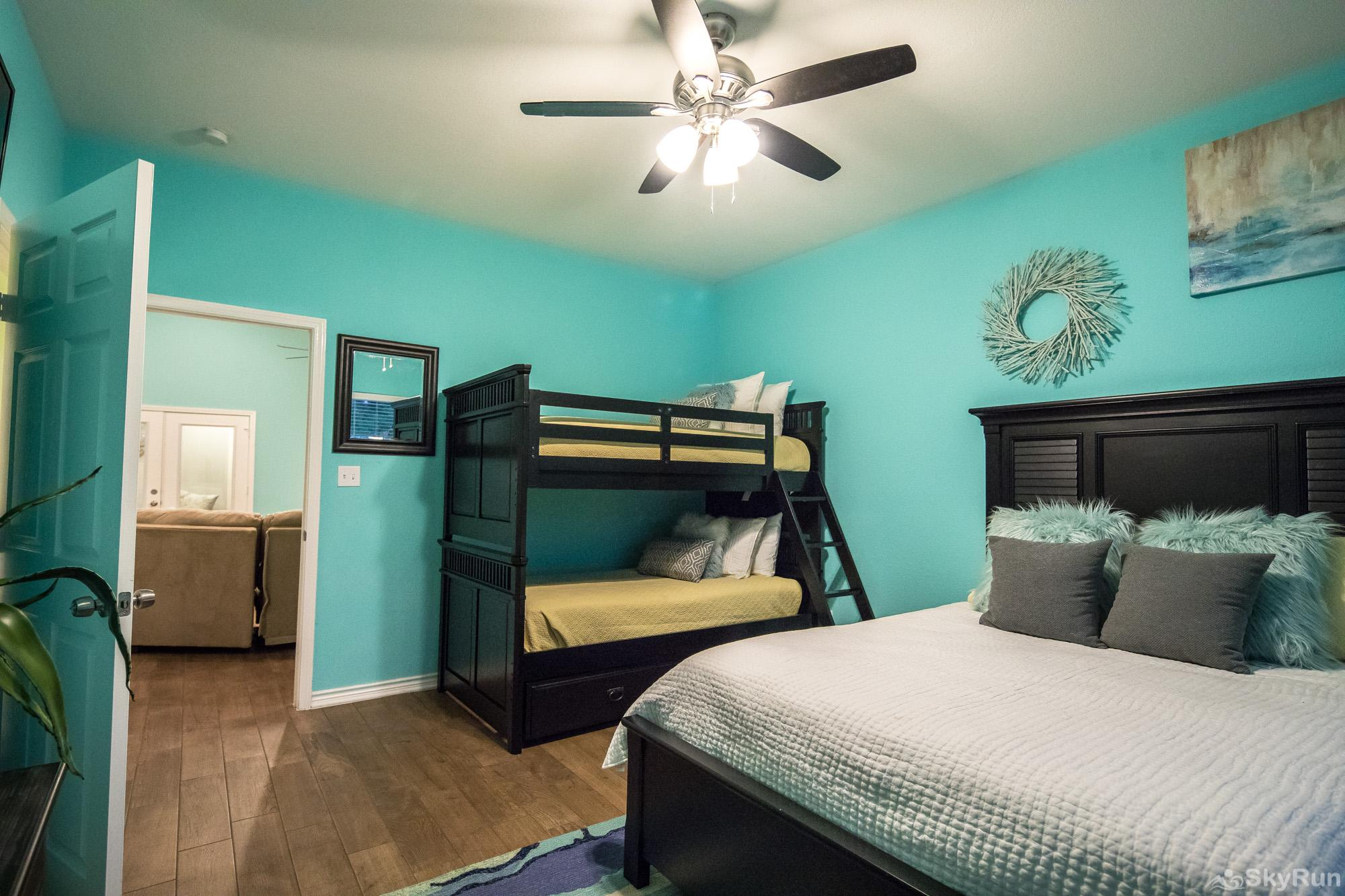 PARADISE POINTE Fourth Bedroom with Queen Bed and Twin Bunks