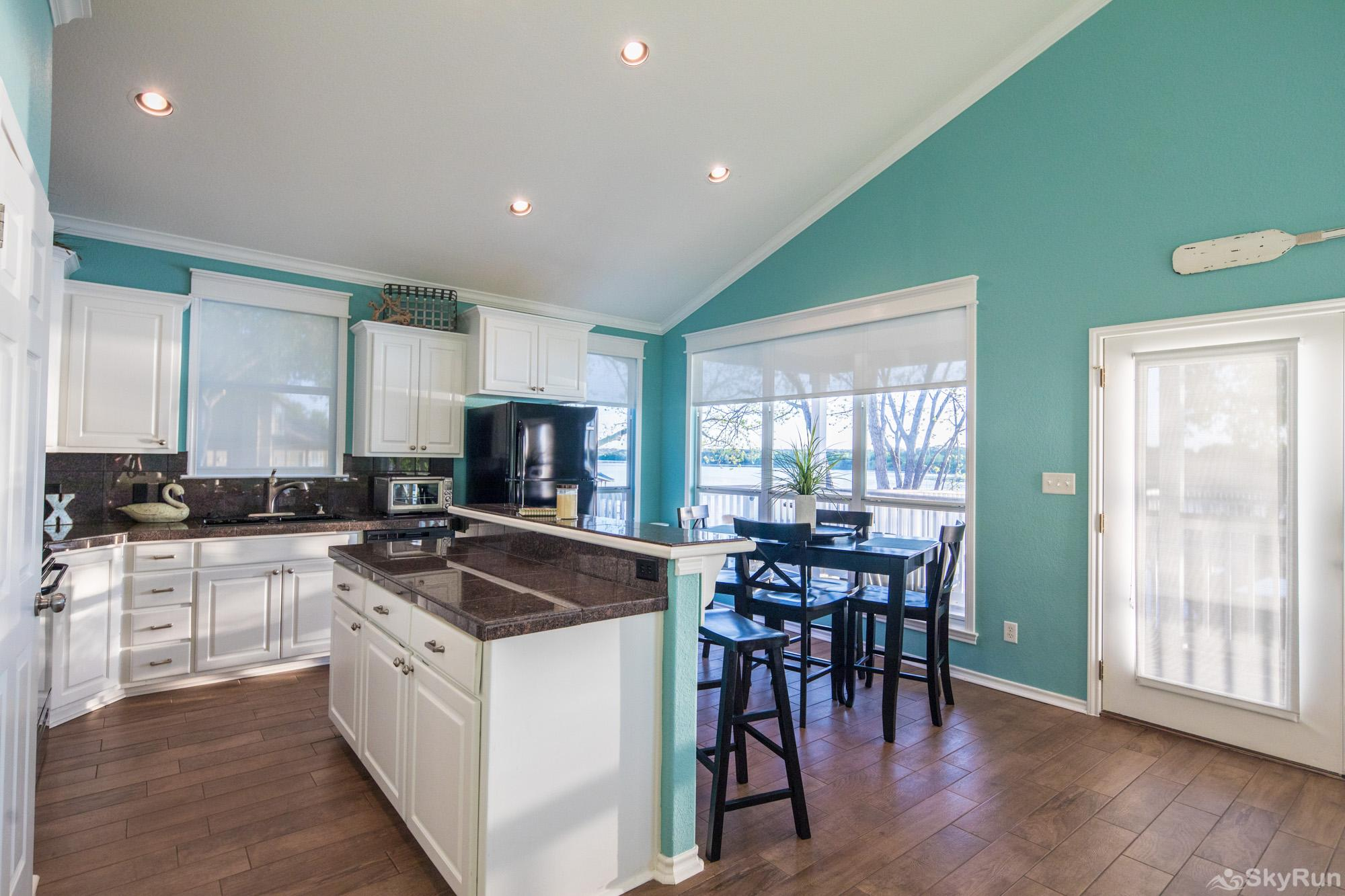 PARADISE POINTE Fully Equipped Kitchen and Dining Area