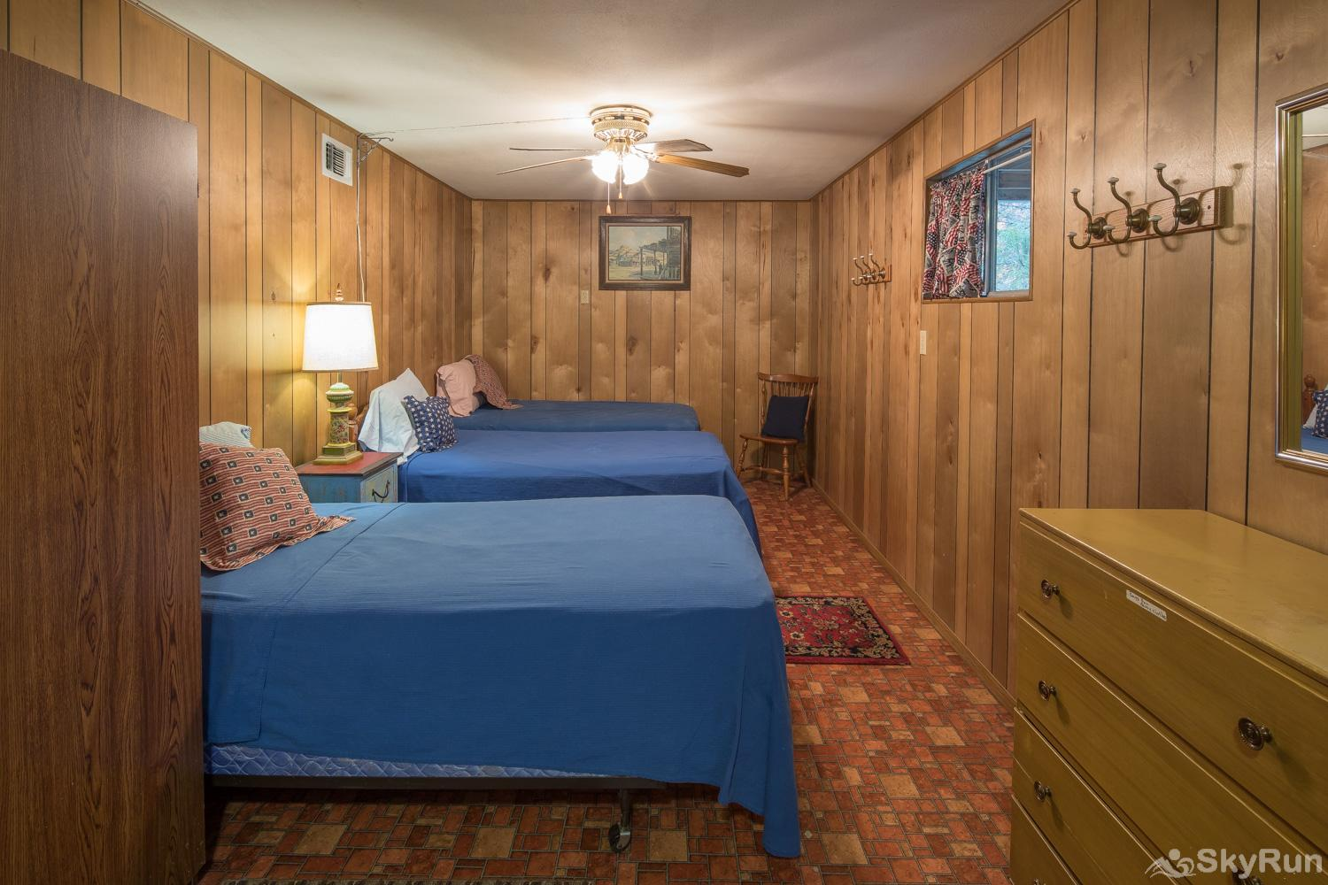 MAC'S PLACE Third Bedroom with 4 Twin Beds, Small Living Area and a Full Bathroom with a Walk-In Shower