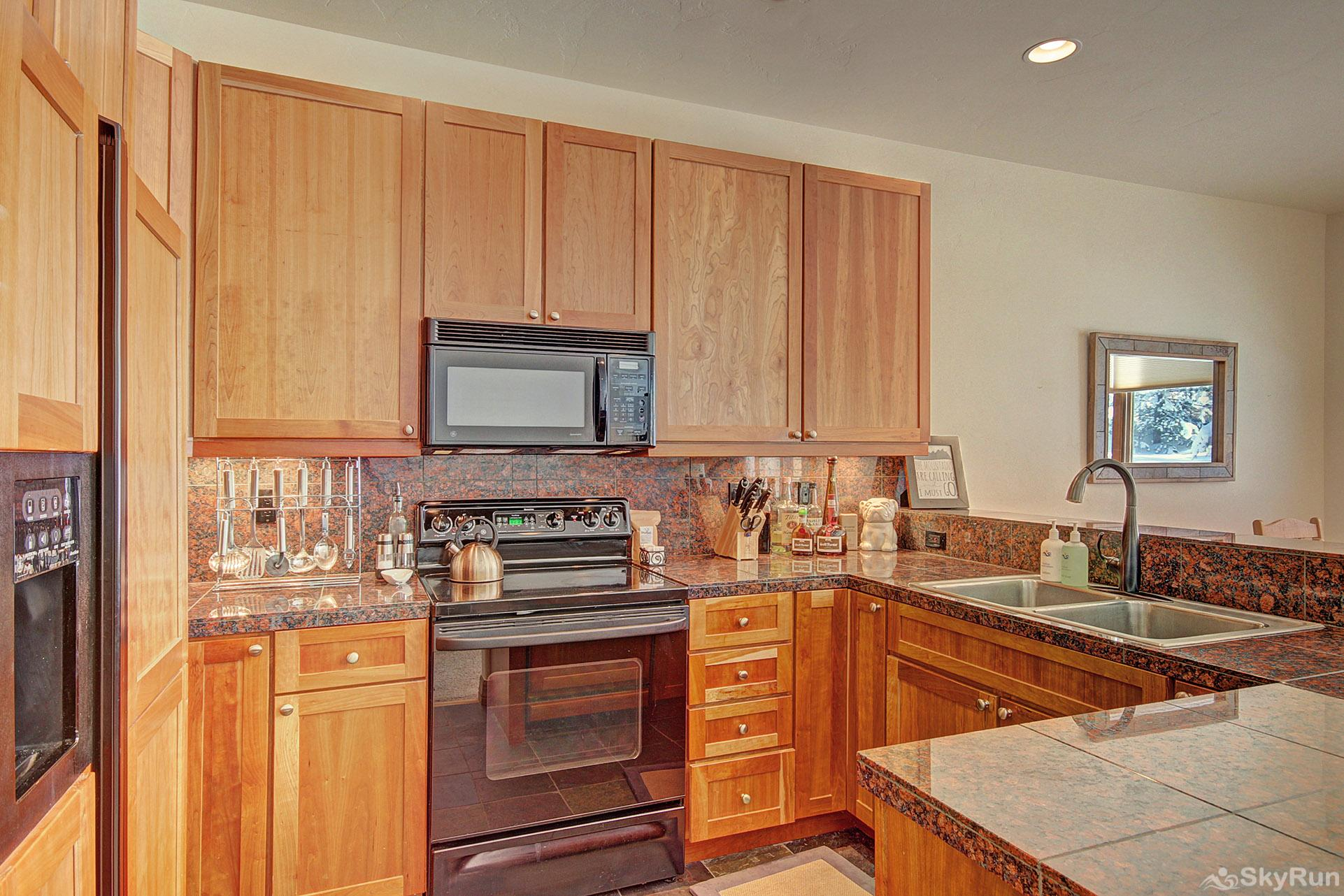 Highland Greens Pine Fully equipped kitchen with modern appliances
