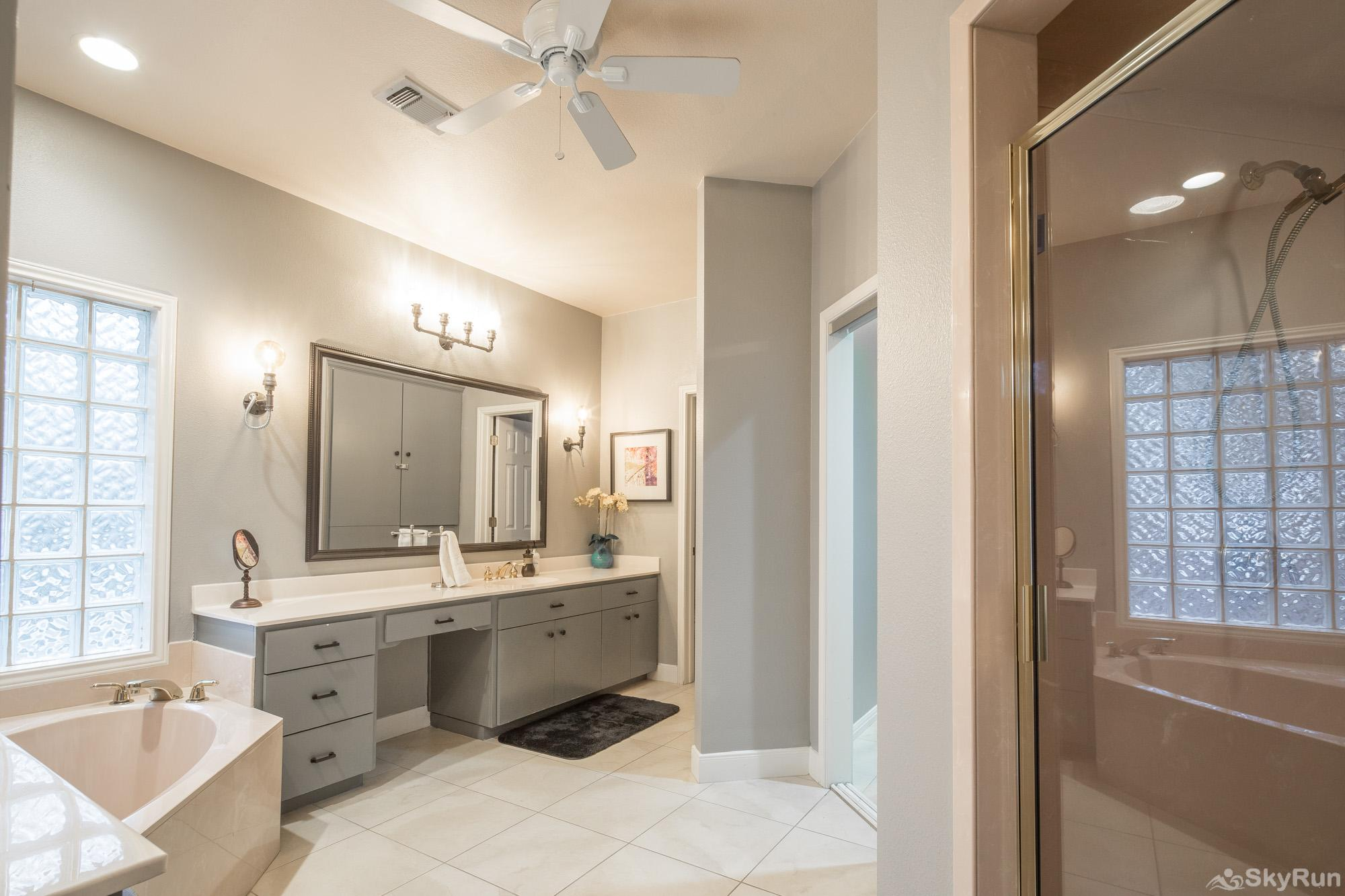 GRUENE VISTA ON THE GUADALUPE Master Bathroom with Large Tub and Walk- In Shower