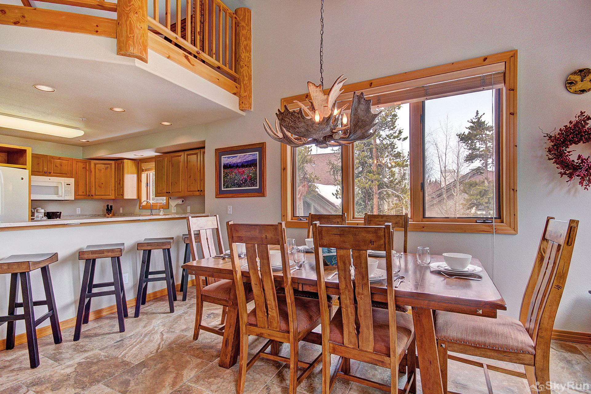 Elk Ridge Retreat Dining table with seating for 8-10, additional seating for 4 at the bar
