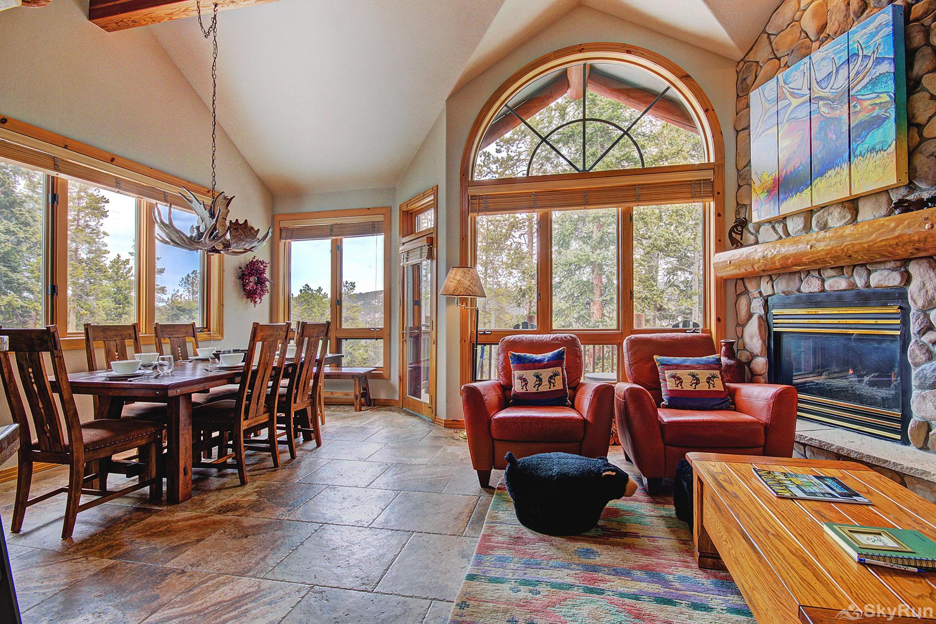 Elk Ridge Retreat Beautiful living area with large windows and gas fireplace