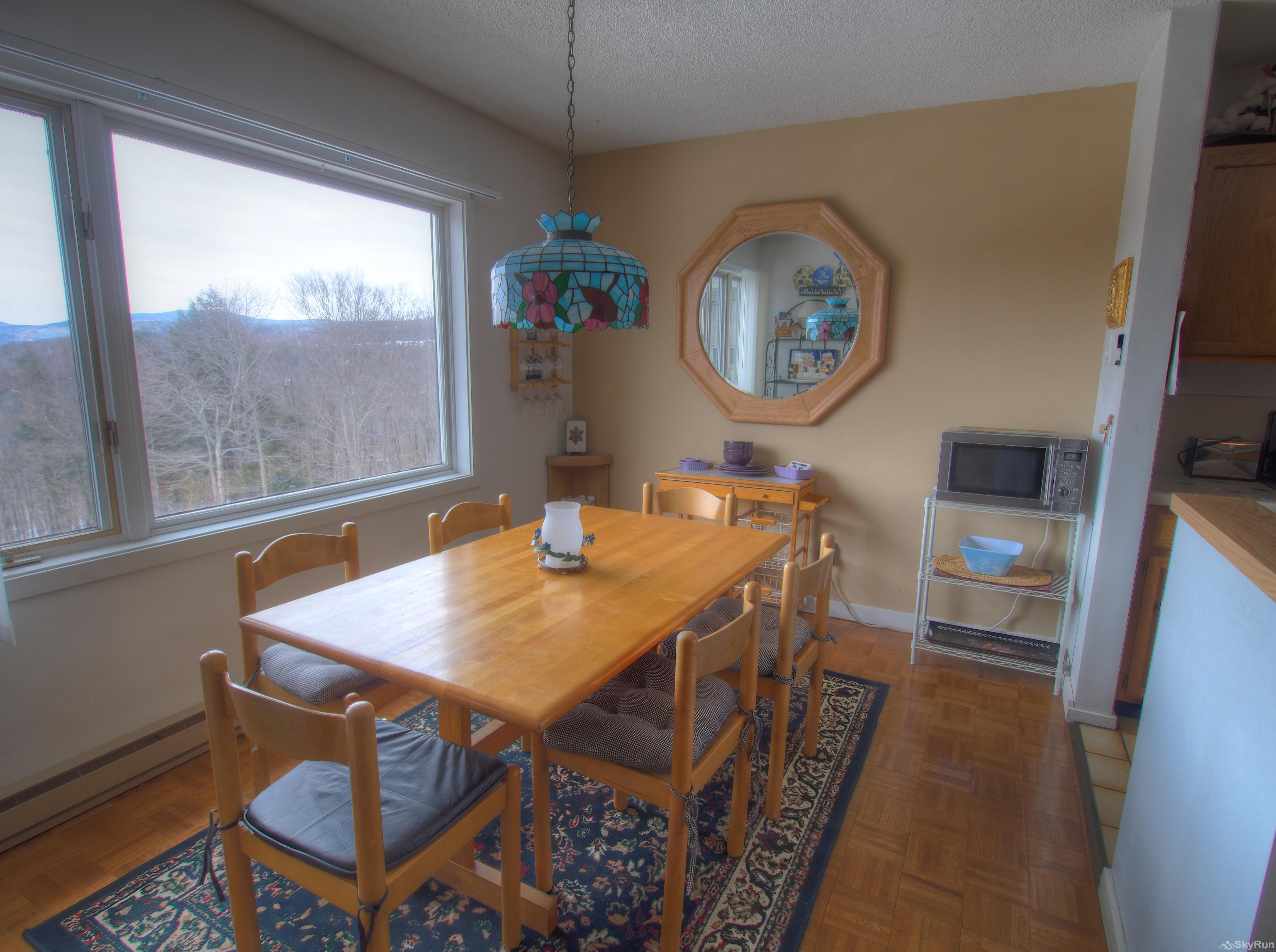14 Snowside Dining area with fabulous views out the large window