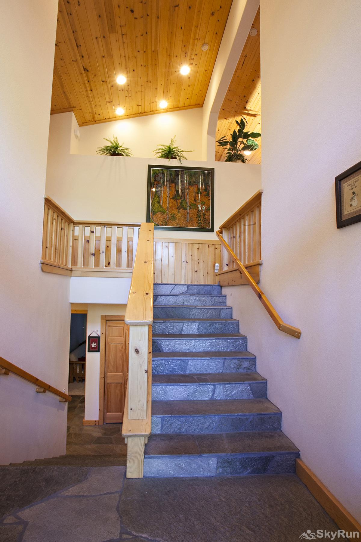 Alder Creek Mountain Home at Tahoe Donner Grand entrance with beautiful flooring and stairs leading up to main level