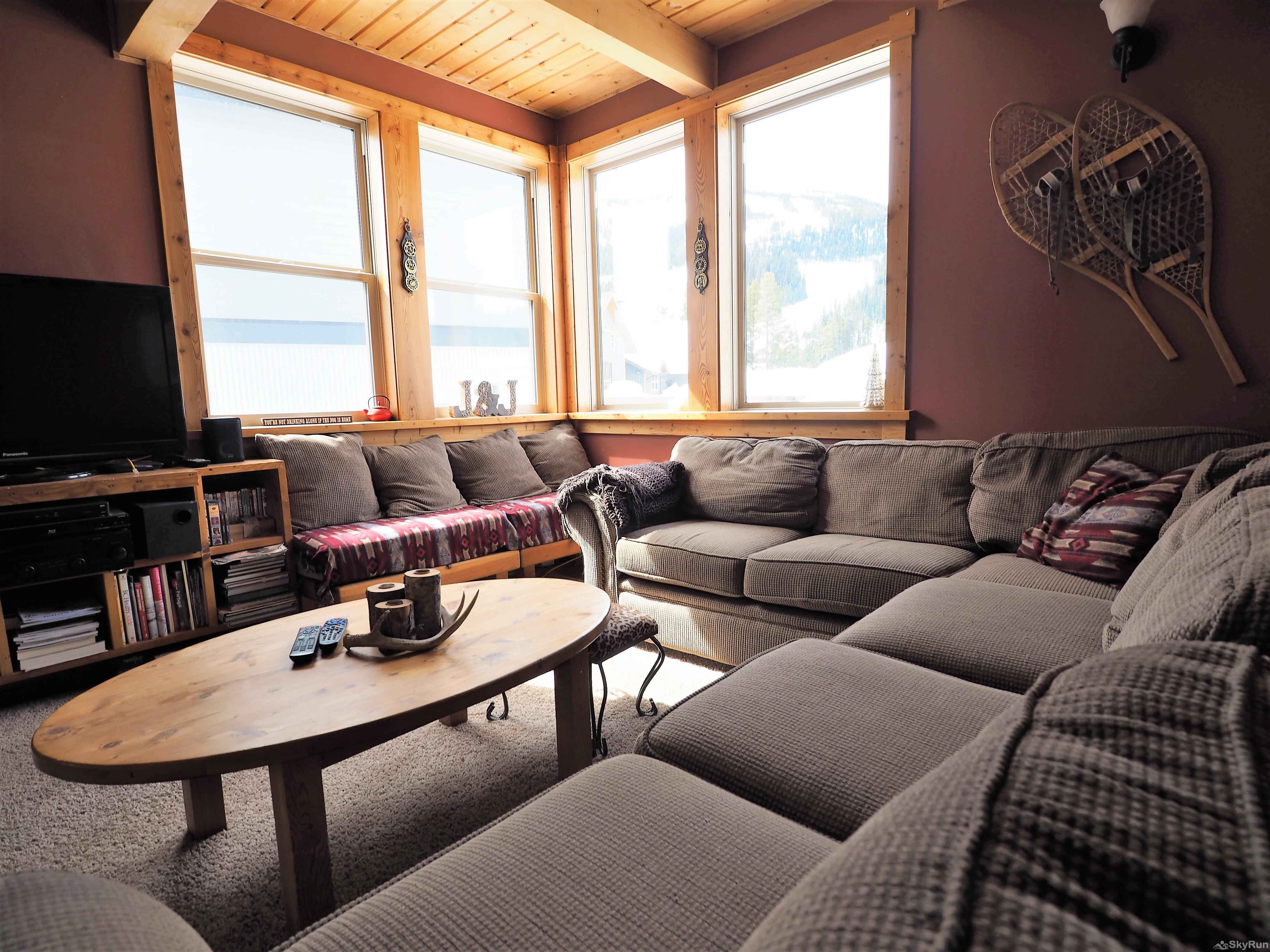 Wildside at Apex The large sectional couch can be hard to leave with the amazing views and warm wood fire place