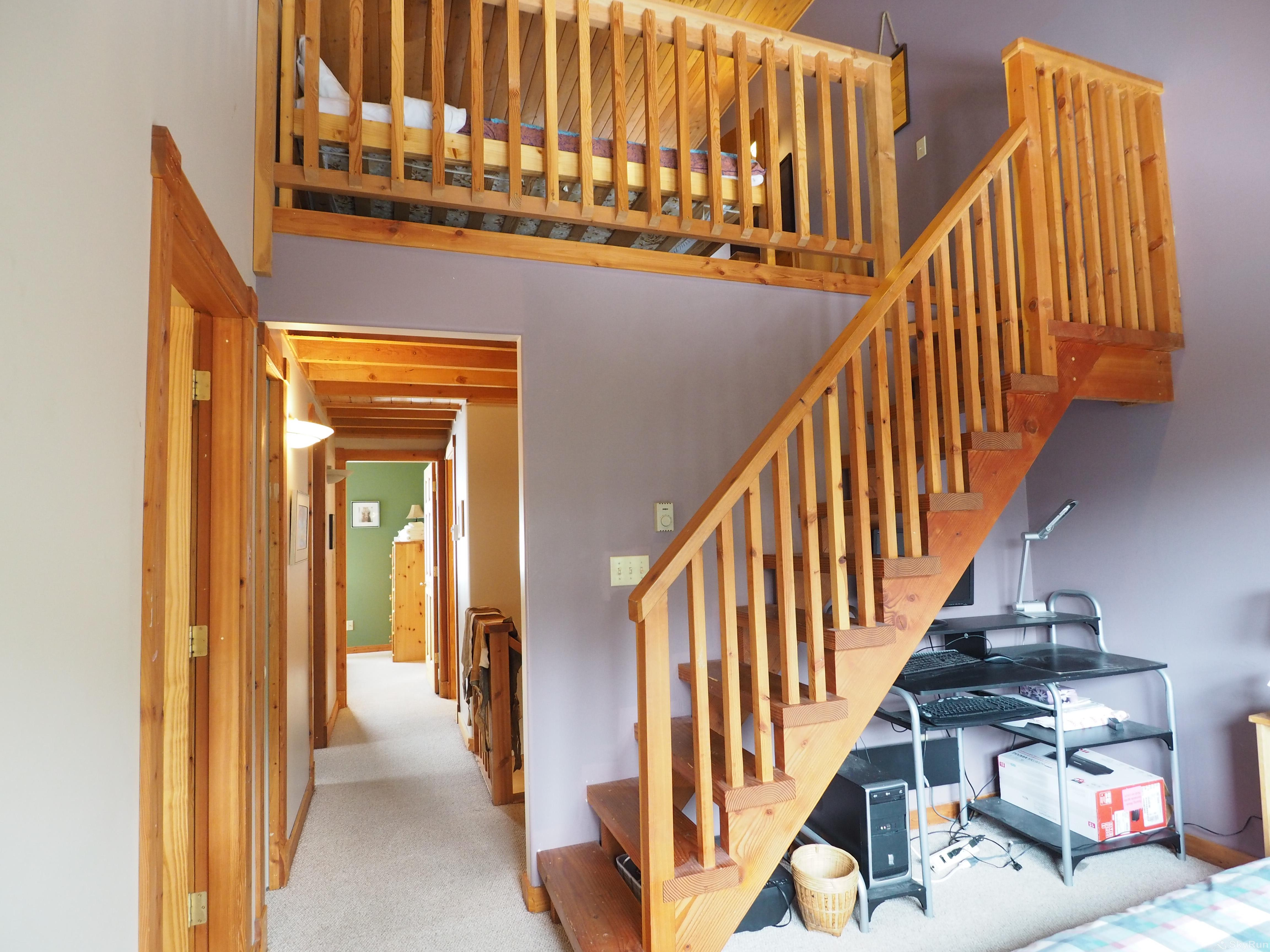 Wildside at Apex Staircase to the loft and hallway to the master bedroom