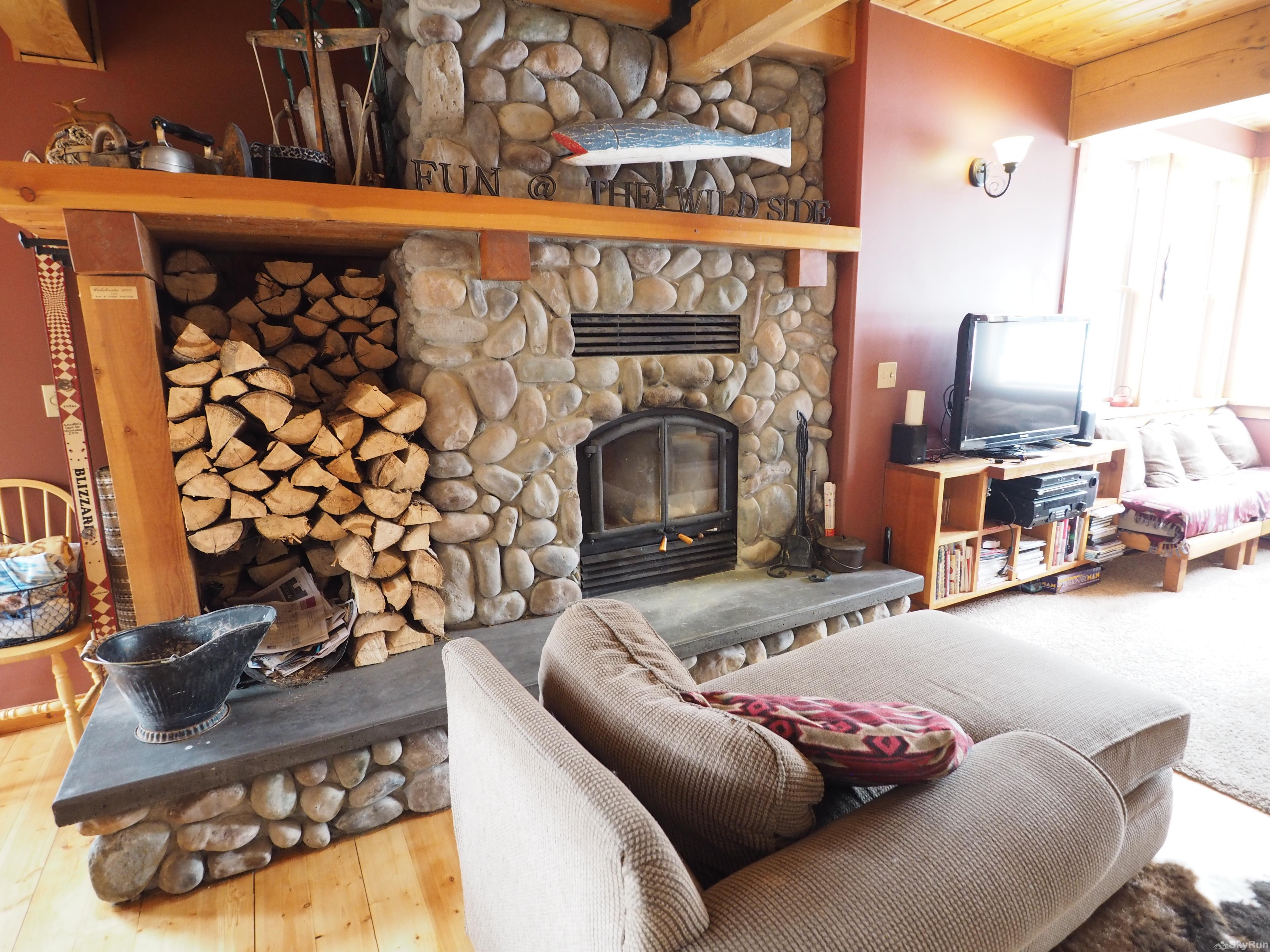 Wildside at Apex The comfortable lounge room provides amazing views of the ski hill and a wood burning fireplace