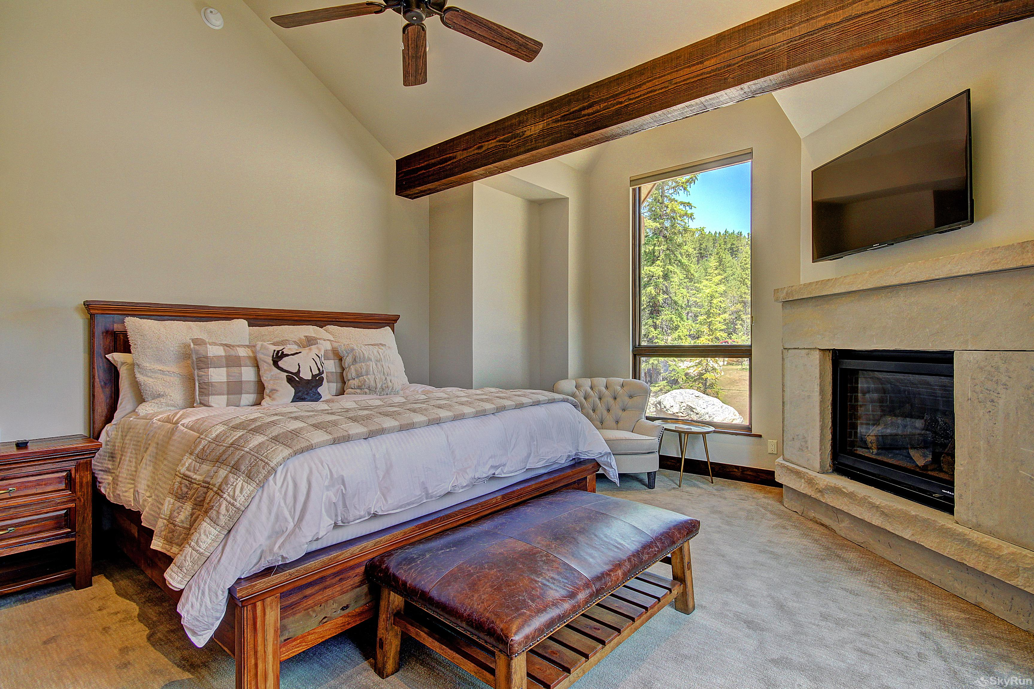 River's Edge Retreat Alternate view of upper level king master suite with TV & gas fireplace