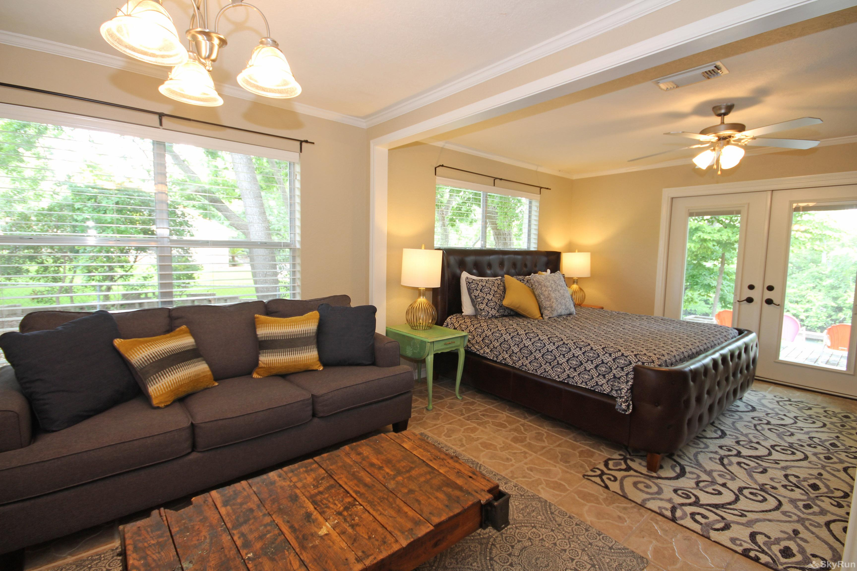 MAVERICK'S RIVER HAUS & GUEST HAUS Large Master Bedroom with King Bed and Queen Sleeper Sofa