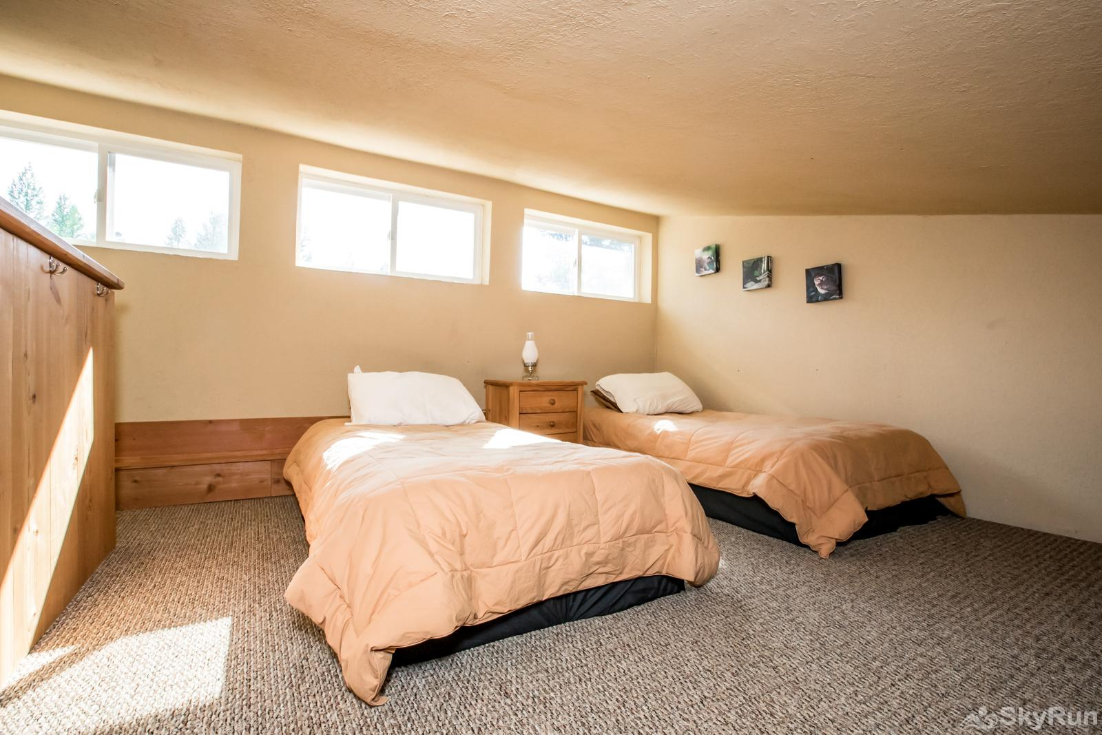Stillwater Mountain Lodge Loft with two single beds above the 3rd bedroom