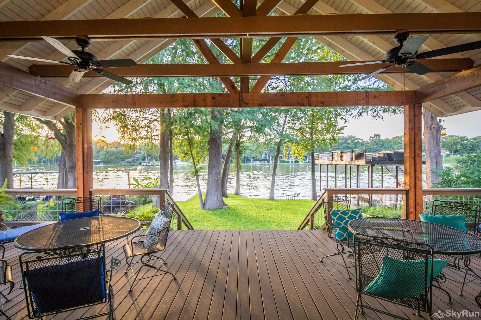 SERENITY SHORES Relaxing River View and Ample Seating on Deck