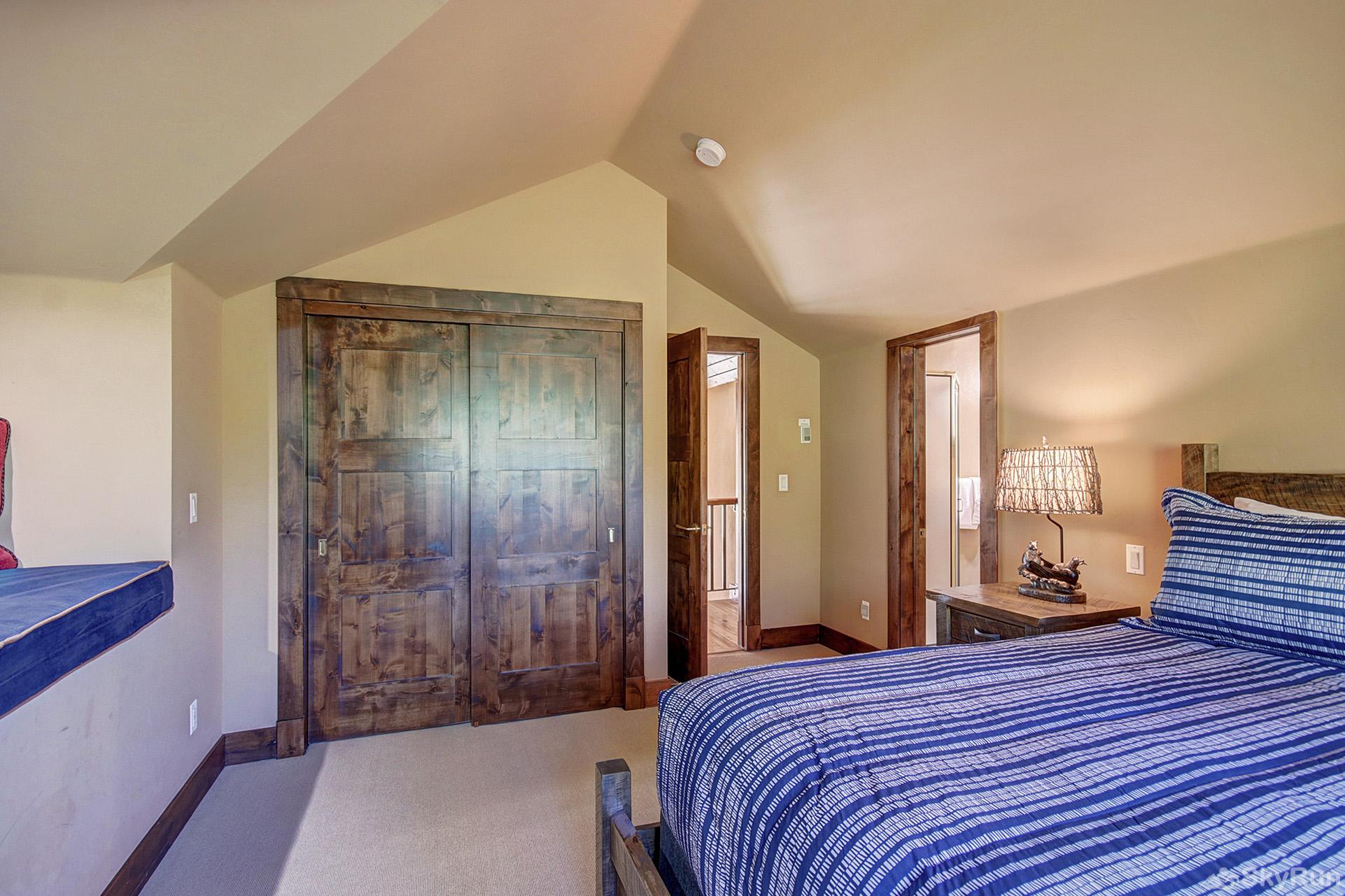 Marksberry Lodge Upper level bedroom with king bed, ensuite bath, flat screen TV