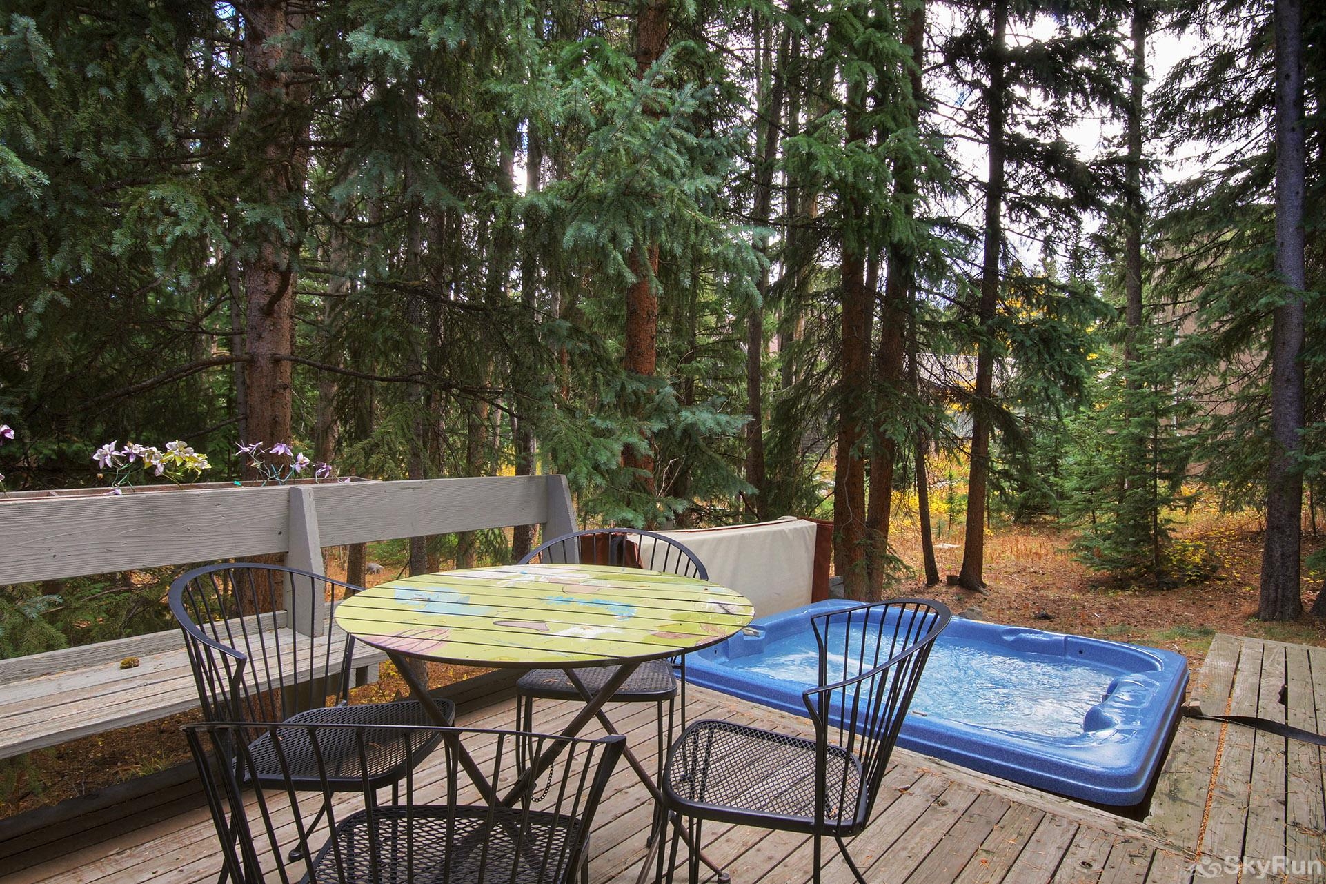 Peace In The Pines Private outdoor porch with seating and hot tub