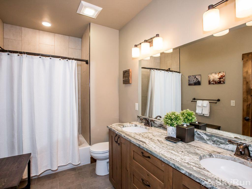 Silver Wolf Penthouse Master bath has a tub/shower and double sink