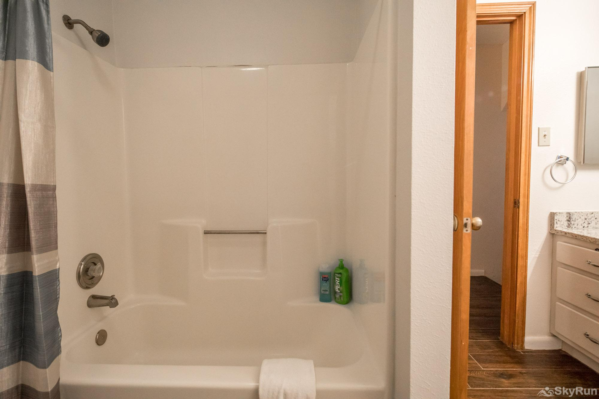 WATER'S EDGE RETREAT Shower/ tub combo in third bathroom