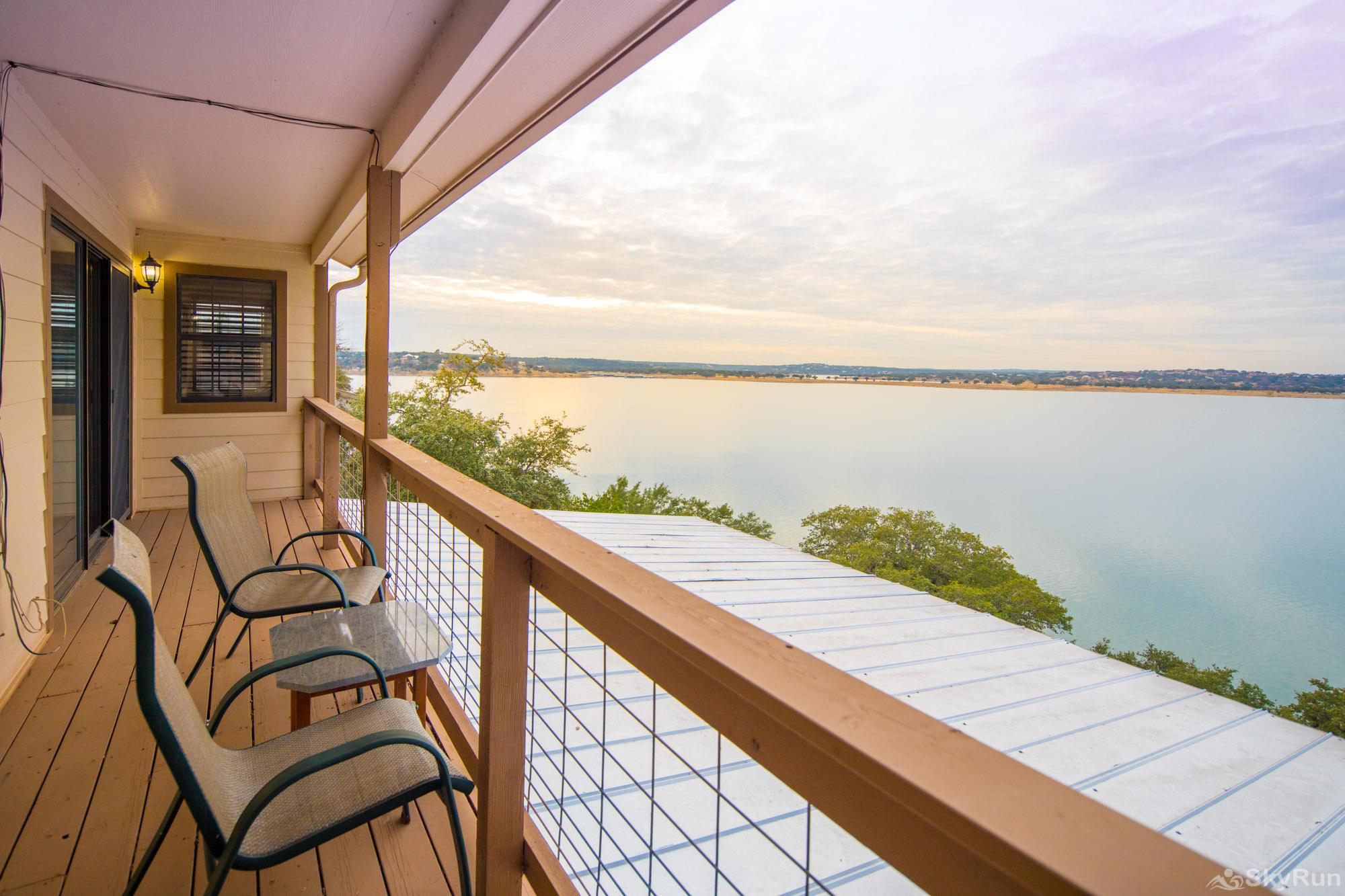 WATER'S EDGE RETREAT Sweeping lake views from master bedroom deck