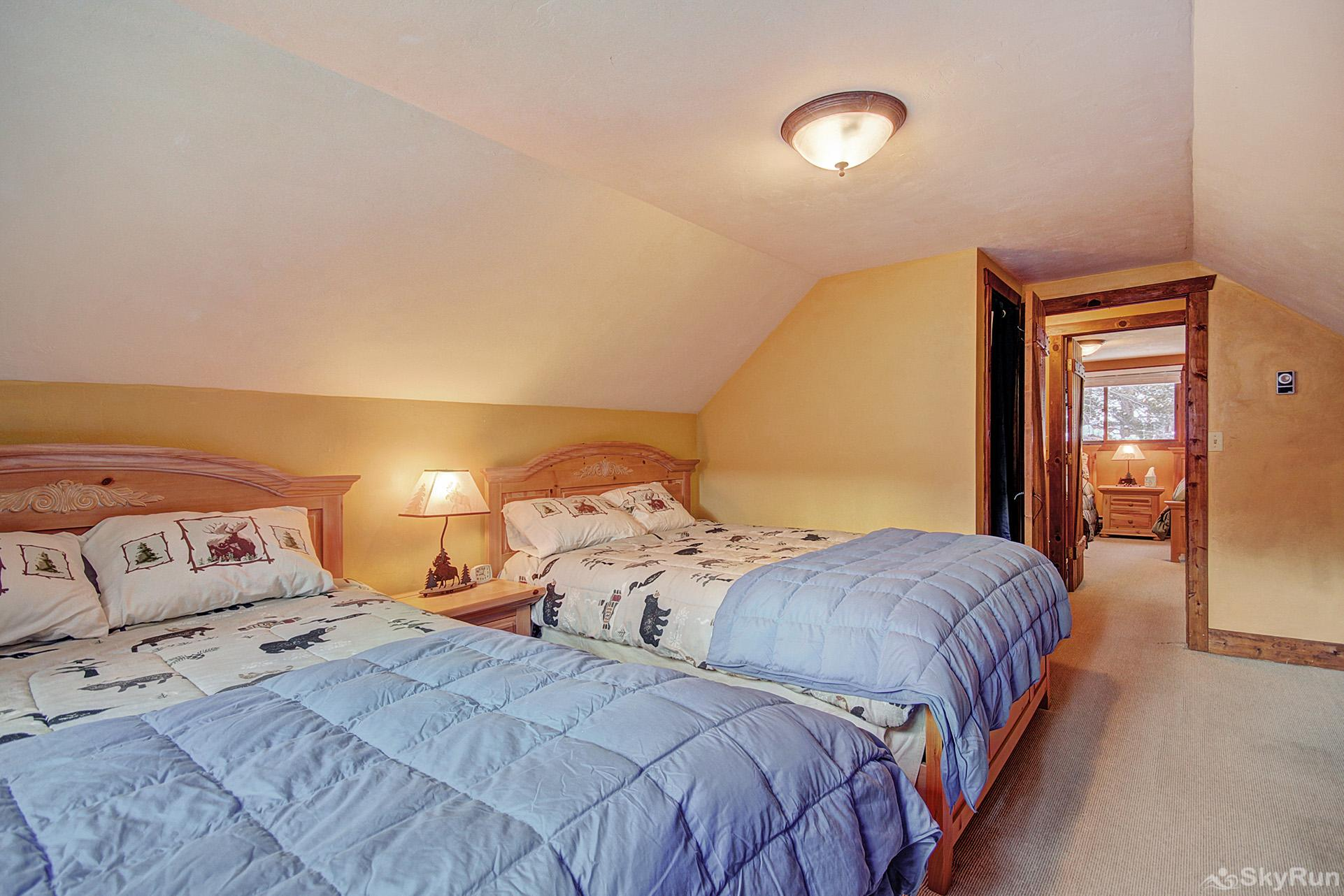 Whispering Pines Upper level bedroom with queen beds