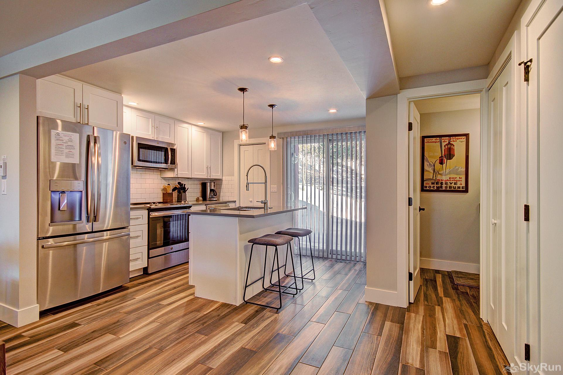 First Last Chance Large kitchen with modern stainless steel appliances