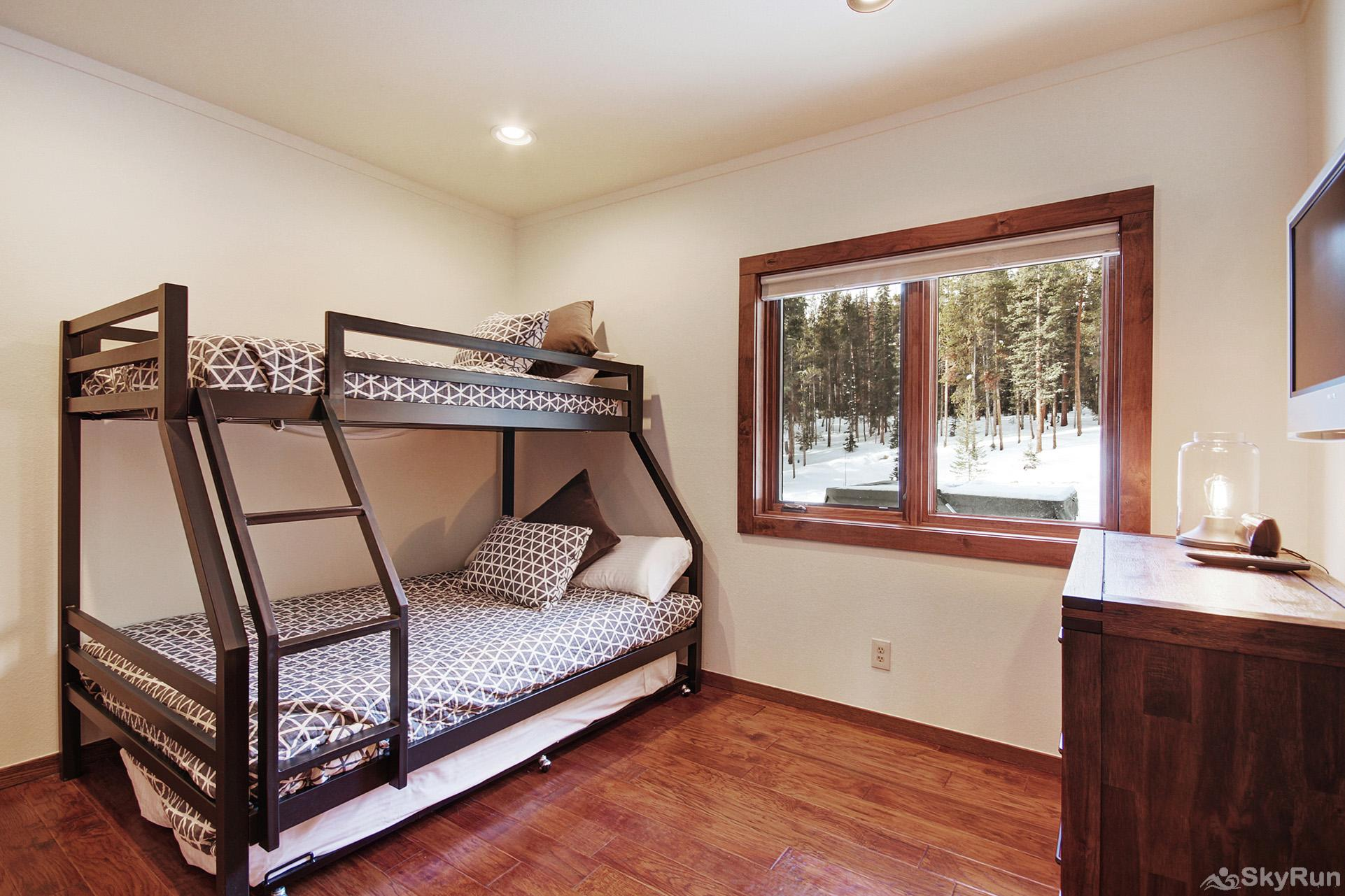 Summit Solitude Estate Additional view of lower level bunk room with twin over full bunk, twin trundle, flat screen TV