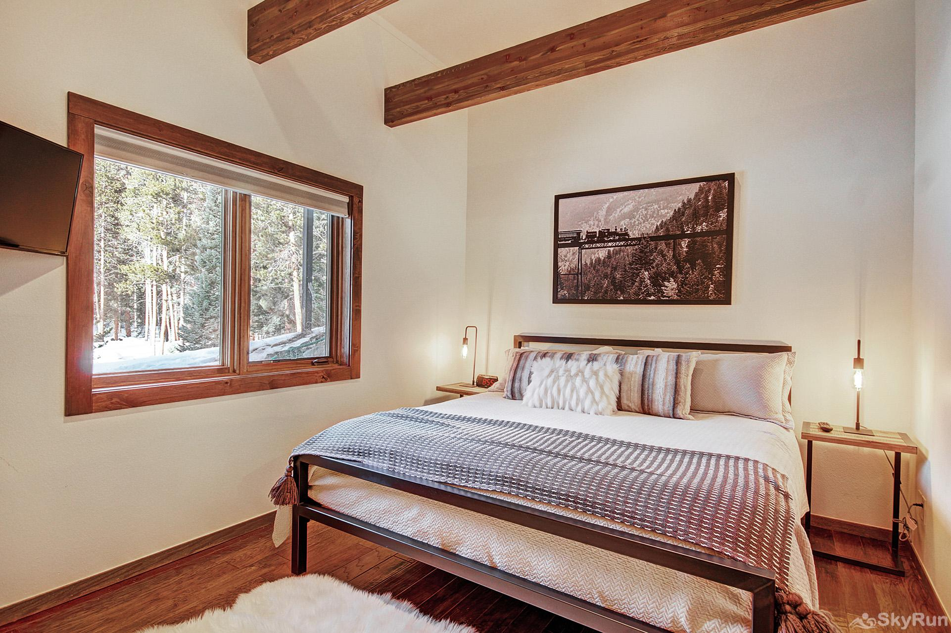 Summit Solitude Estate Lower level king bedroom with ensuite bath