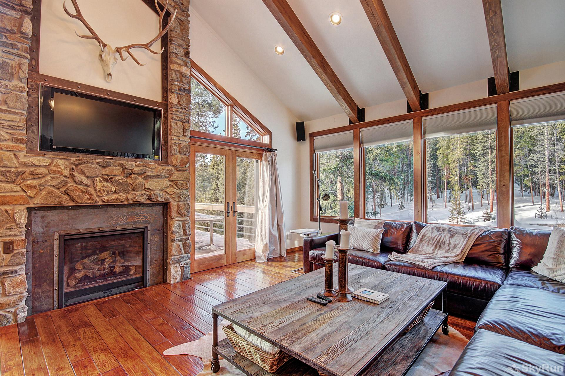 Summit Solitude Estate Spacious living area with gas fireplace and flat screen TV