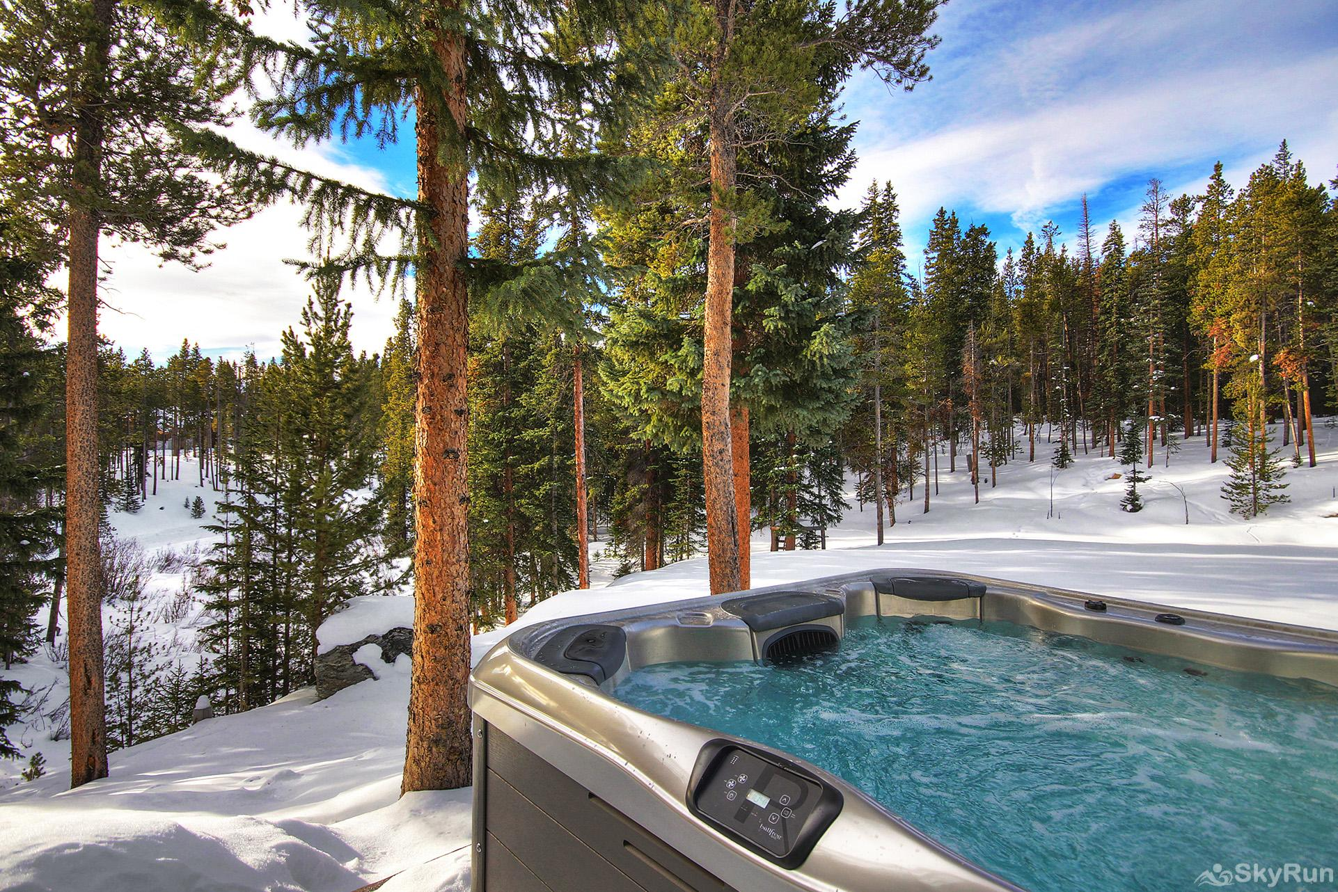 Summit Solitude Estate Soak in the private outdoor hot tub after a day of fun adventures!