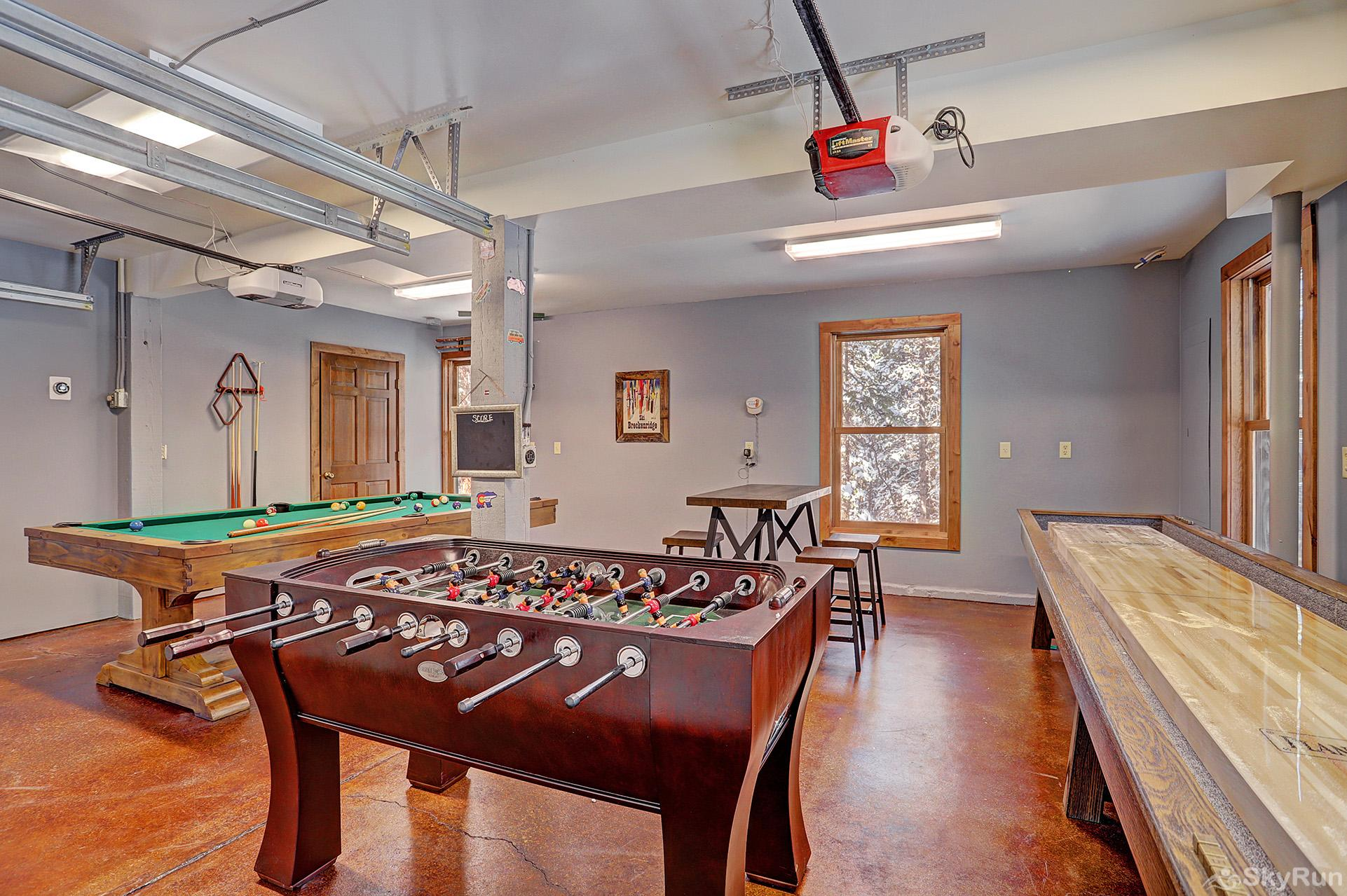 Summit Solitude Estate Carriage house game room with foosball table, shuffleboard