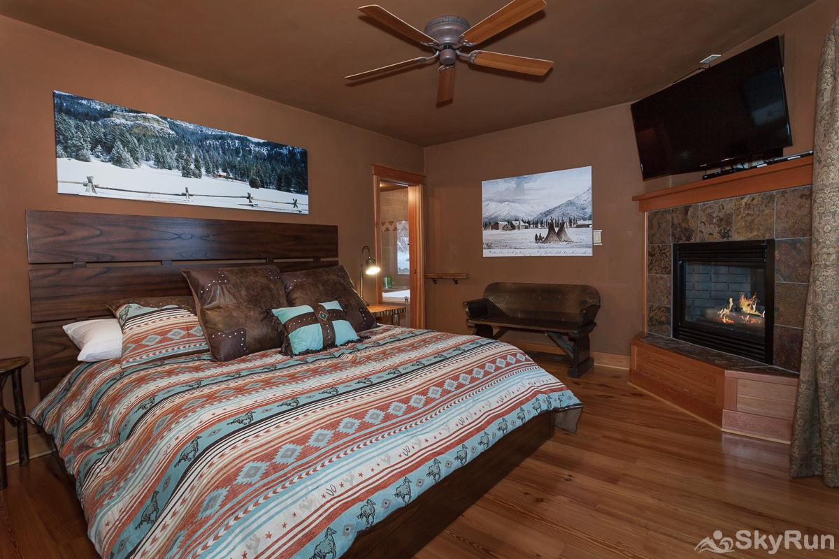 Highland Huckleberry Lodge The Bison Master Suite boasts a new king sized bed, fireplace, large bathroom and easy access to the hot tub.