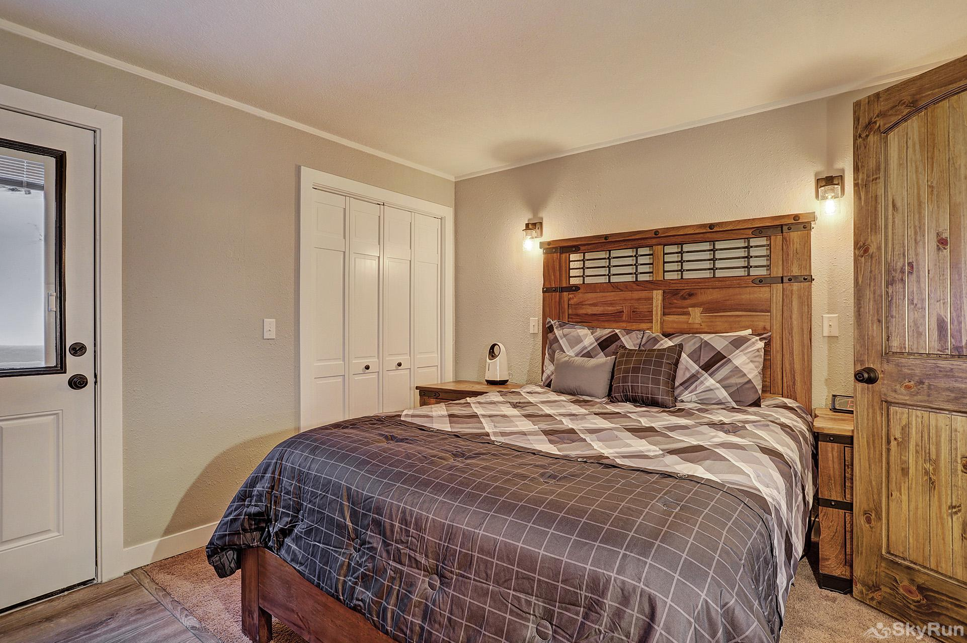 Knotty Pine Lodge Main level queen bedroom with ensuite bath