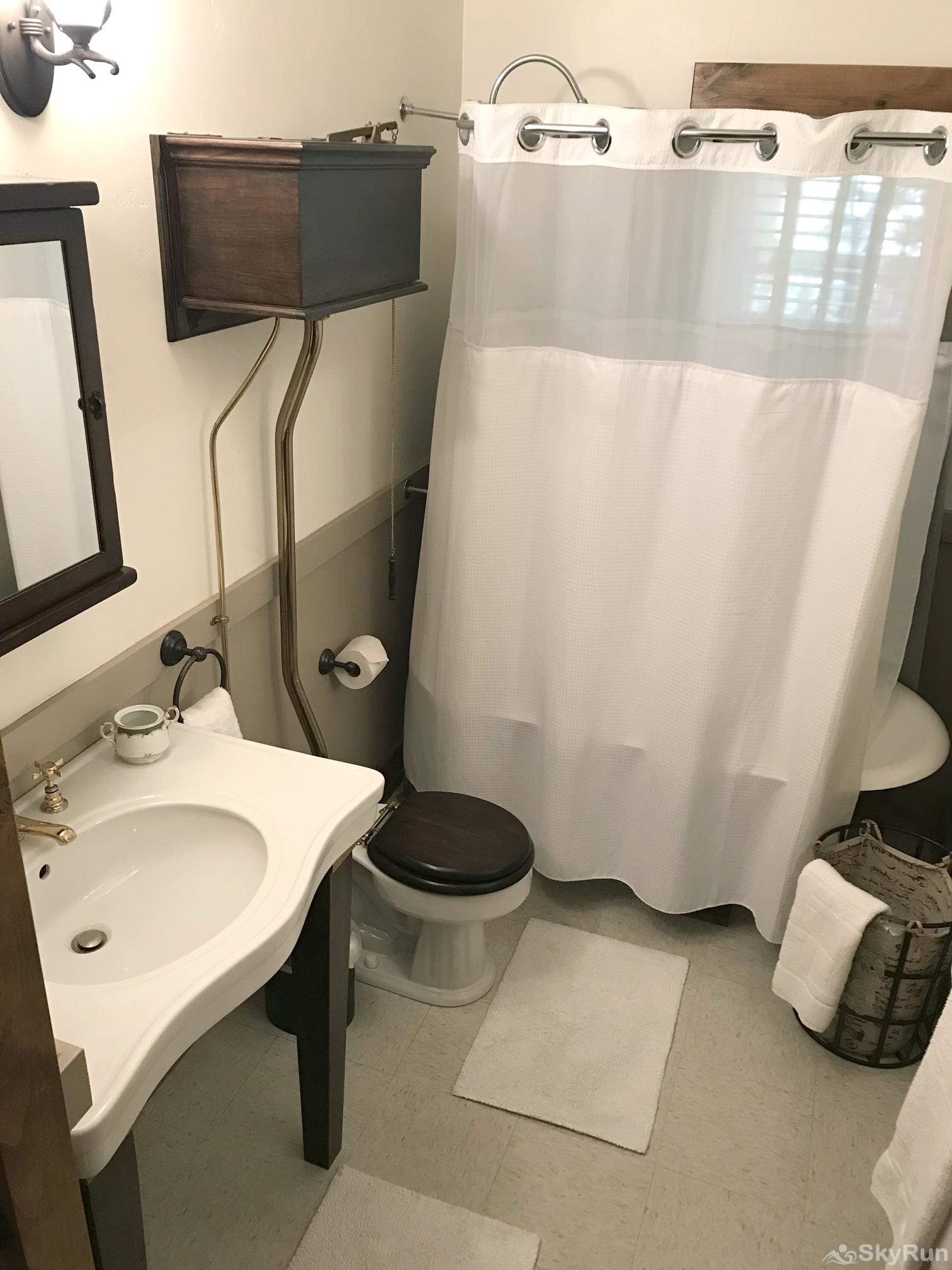 Whitefish River Inn Enjoy this masterfully restored bathroom with all the little extras.