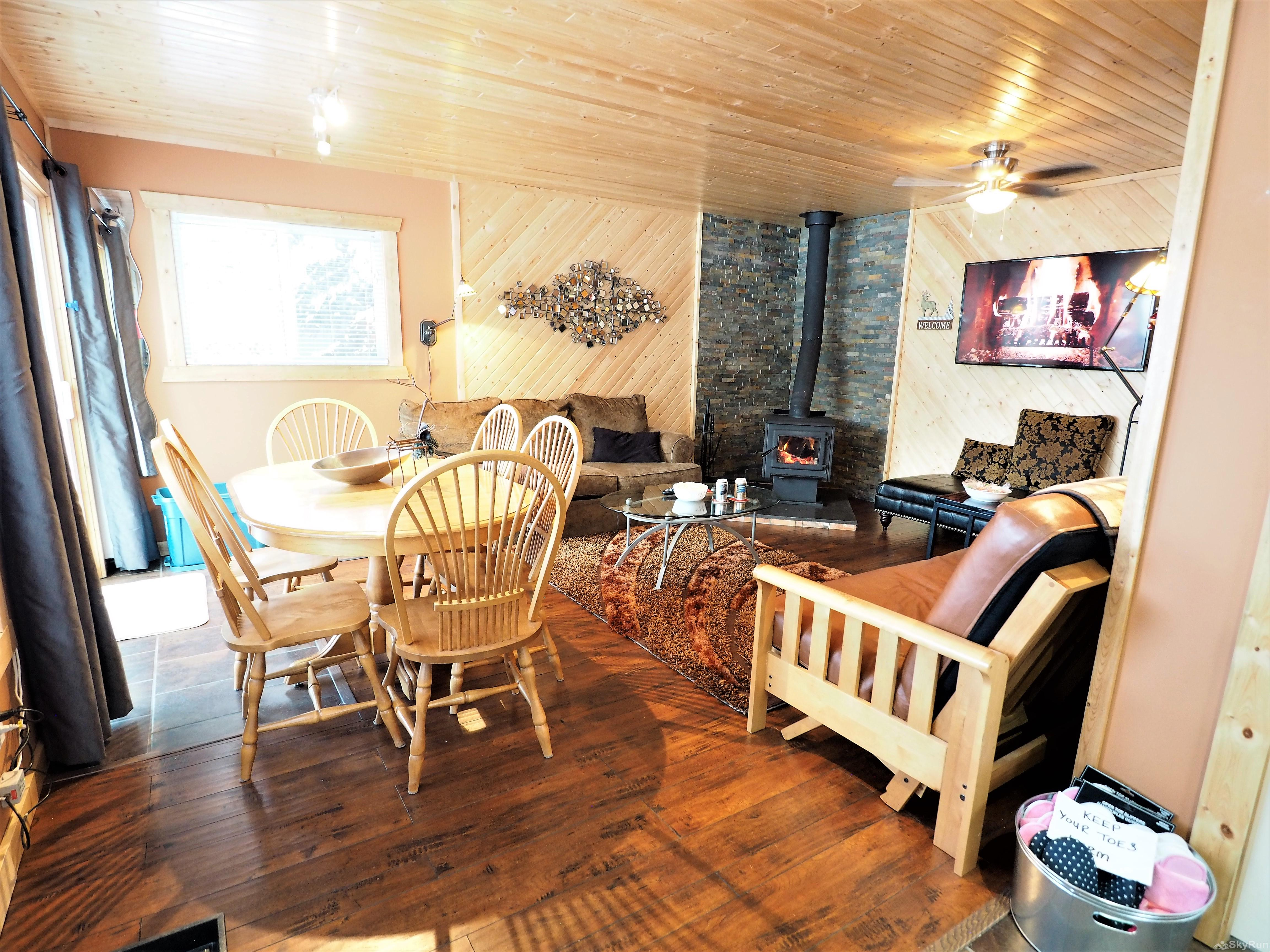 Mountain Air Retreat The cozy open living room with wood burning fireplace