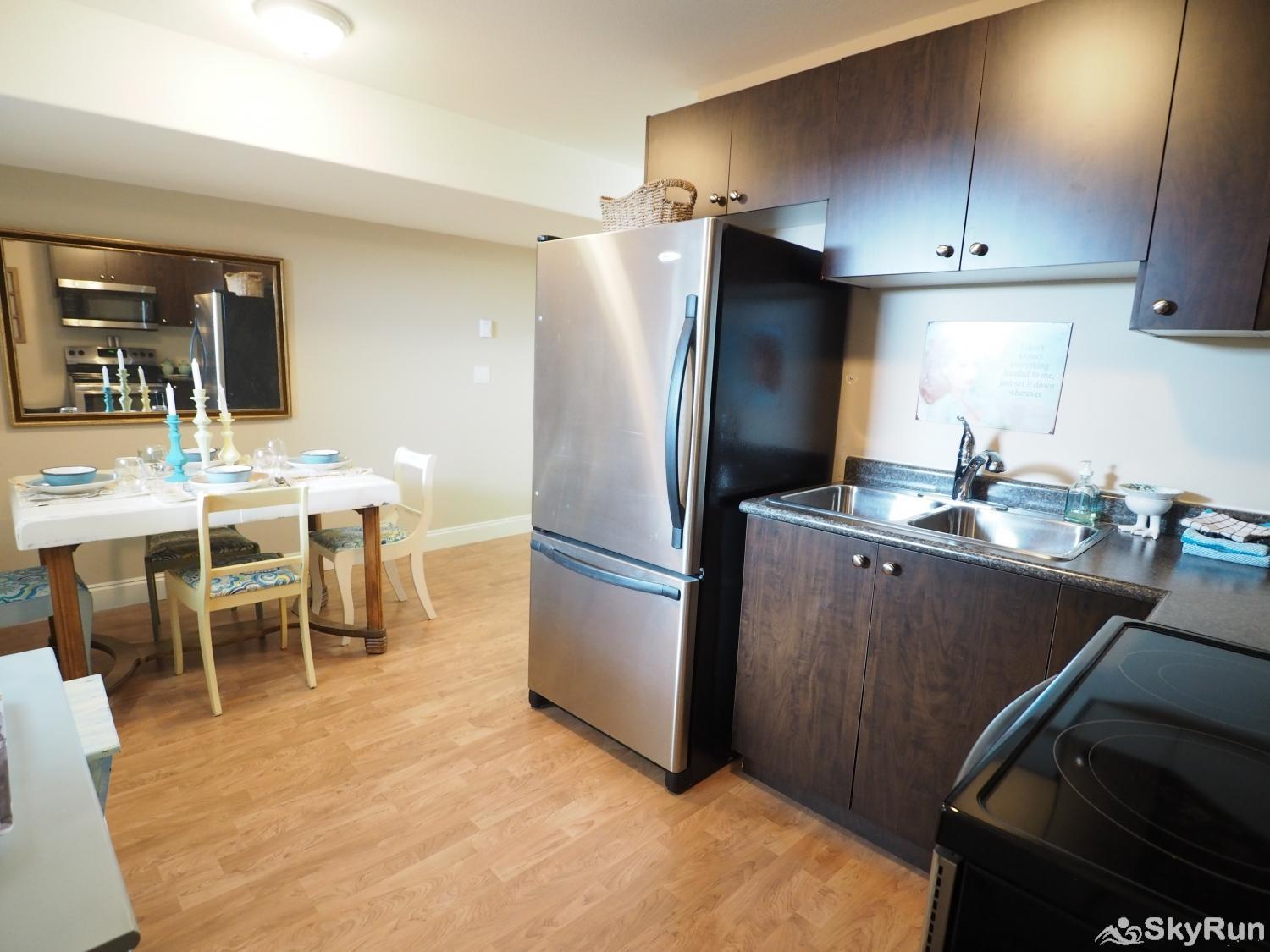Old Summerland 4 bedroom townhouse Basement suite kitchen and living room