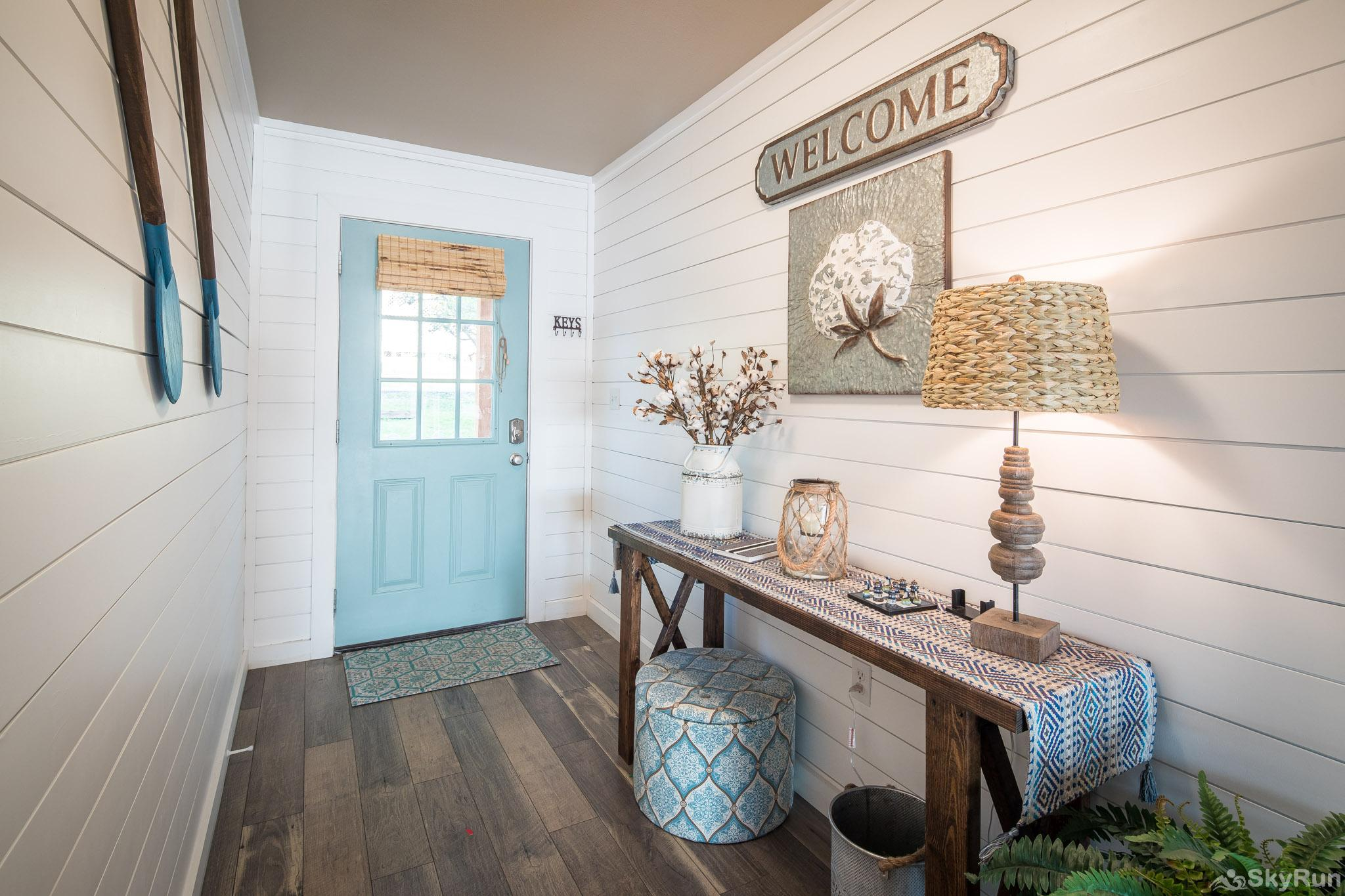 CLIFF HOUSE AT CANYON LAKE Charming entryway with shiplap and unique decor