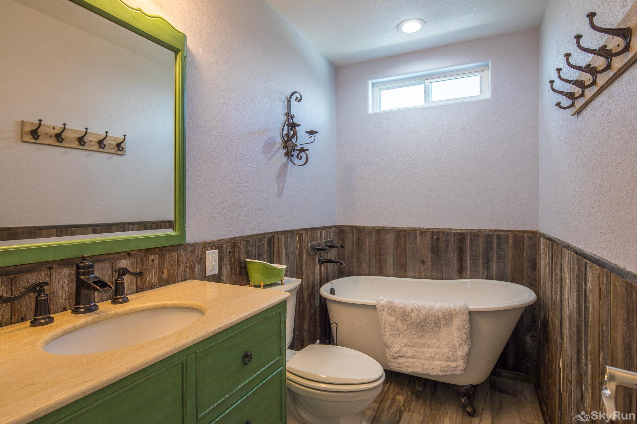 LEDGEROCK POINTE Second bathroom with clawfoot soaking tub