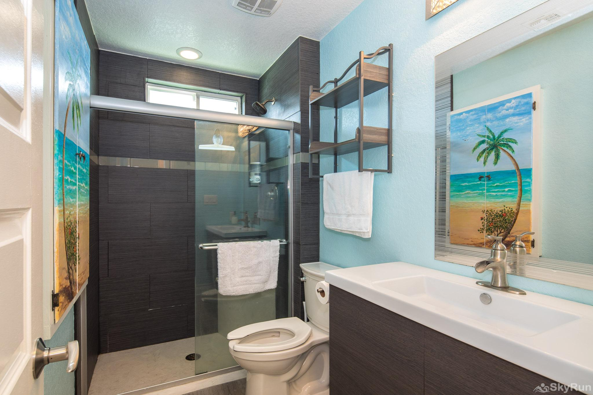 LEDGEROCK POINTE Beautiful bathroom with sleek tiled, walk-in shower