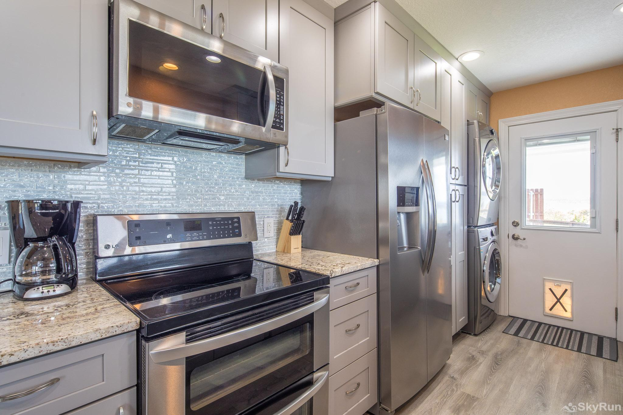 LEDGEROCK POINTE Stainless steel appliances in beautifully updated kitchen